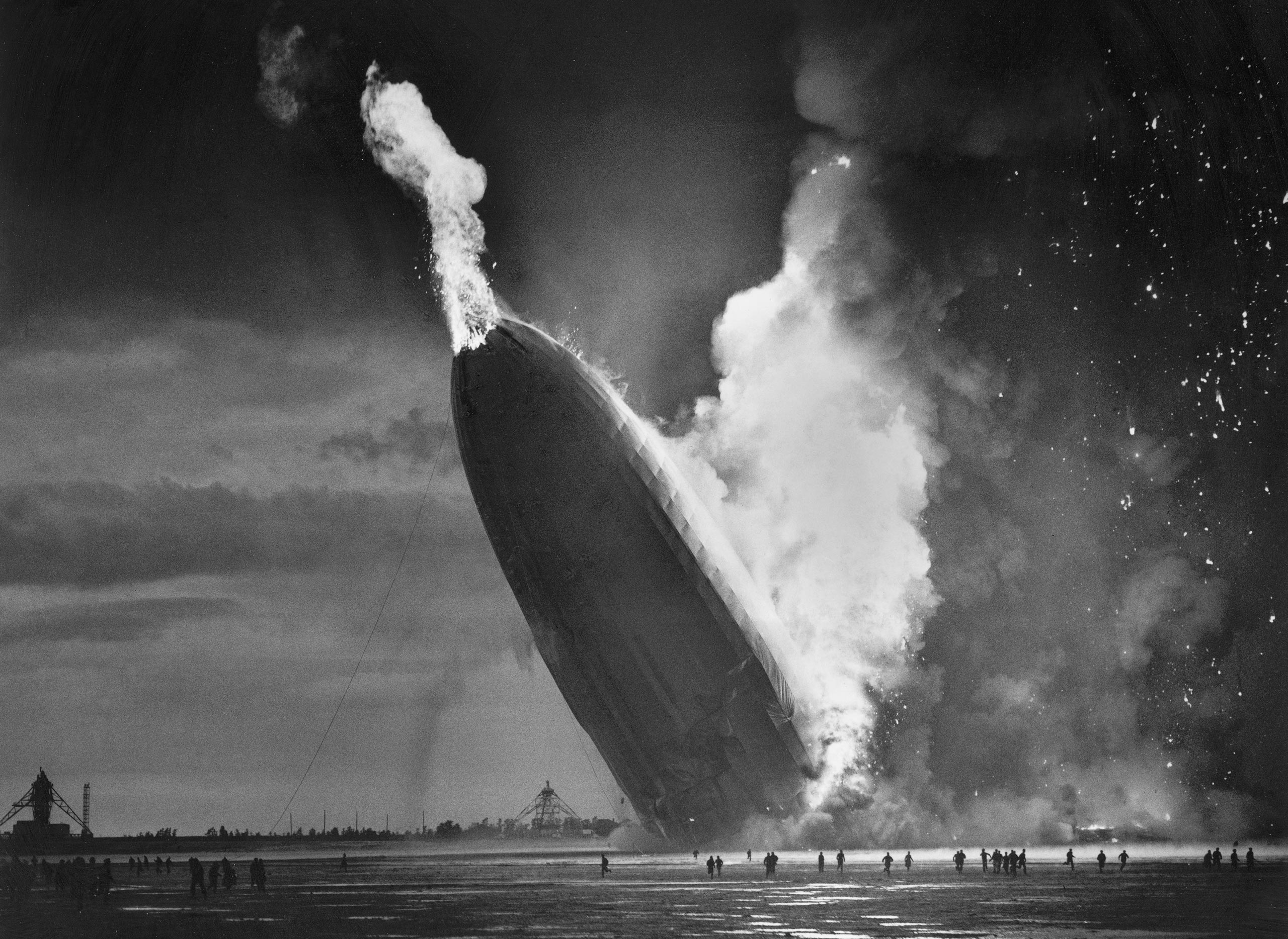 The German dirigible Hindenburg crashes to earth, tail first, in flaming ruins after exploding on May 6, 1937, at the U.S. Naval Station in Lakehurst, N.J.