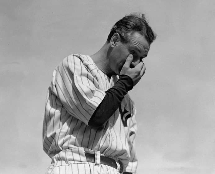 New York Yankees' Lou Gehrig wipes away a tear while speaking during a sold-out tribute at Yankee Stadium on July 4, 1939.