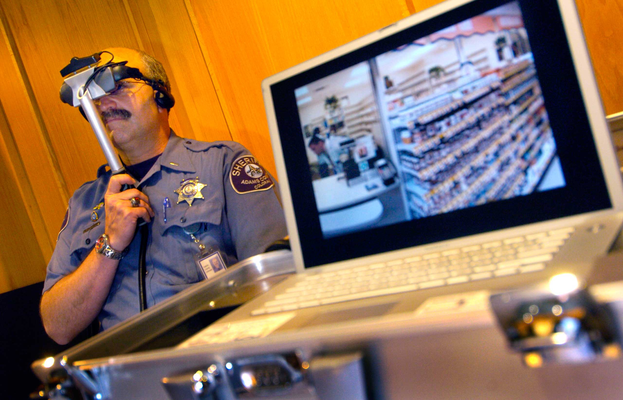 2006                                                              Lt. David Shipley of the Adams County Sheriff's Department watched an interactive video that replicated the experiences of a schizophrenic patient having auditory and visual hallucinations while attempting to refill a prescription at a pharmacy.