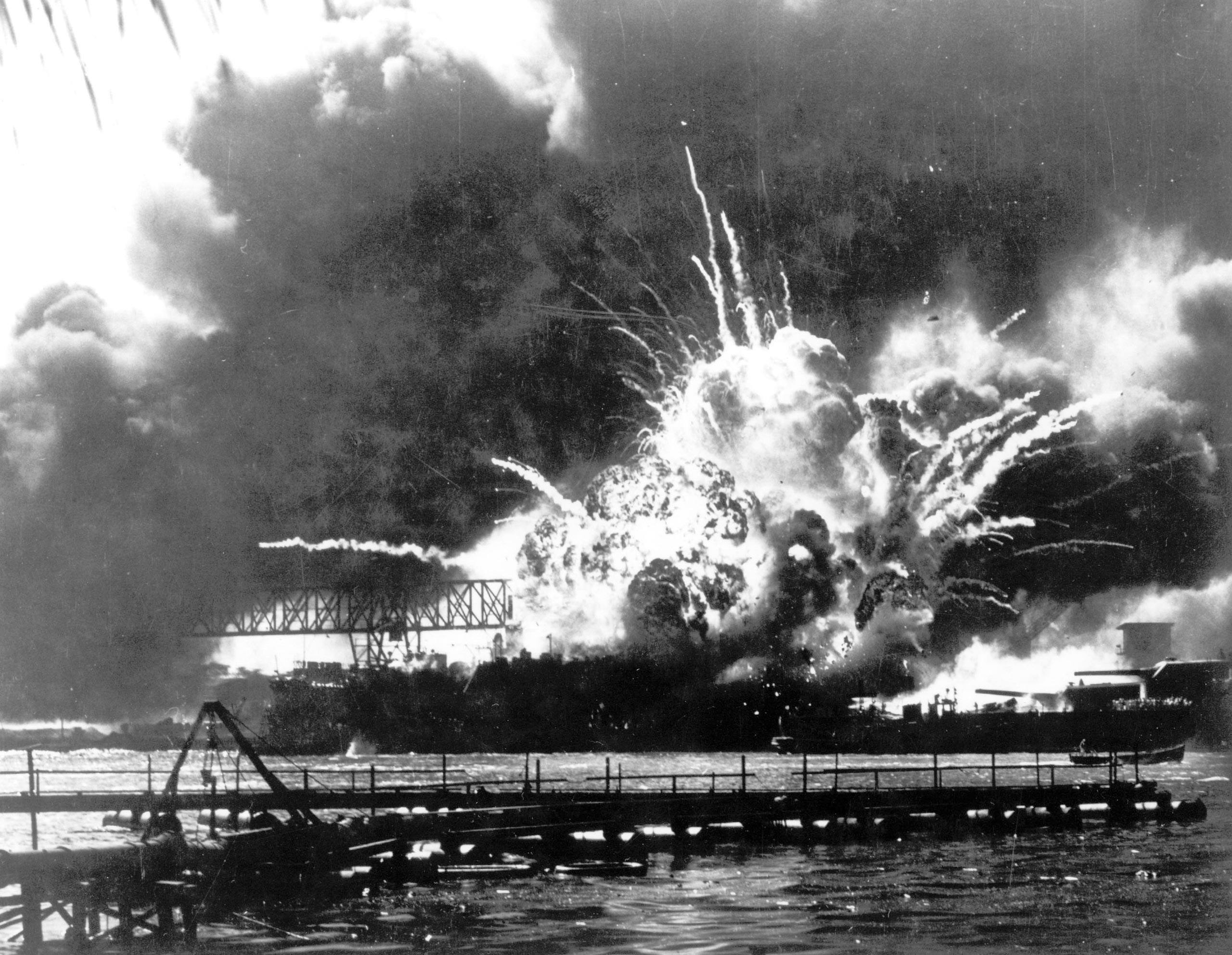 The destroyer USS Shaw explodes after being hit by bombs during the Japanese surprise attack on Pearl Harbor on Dec. 7, 1941.