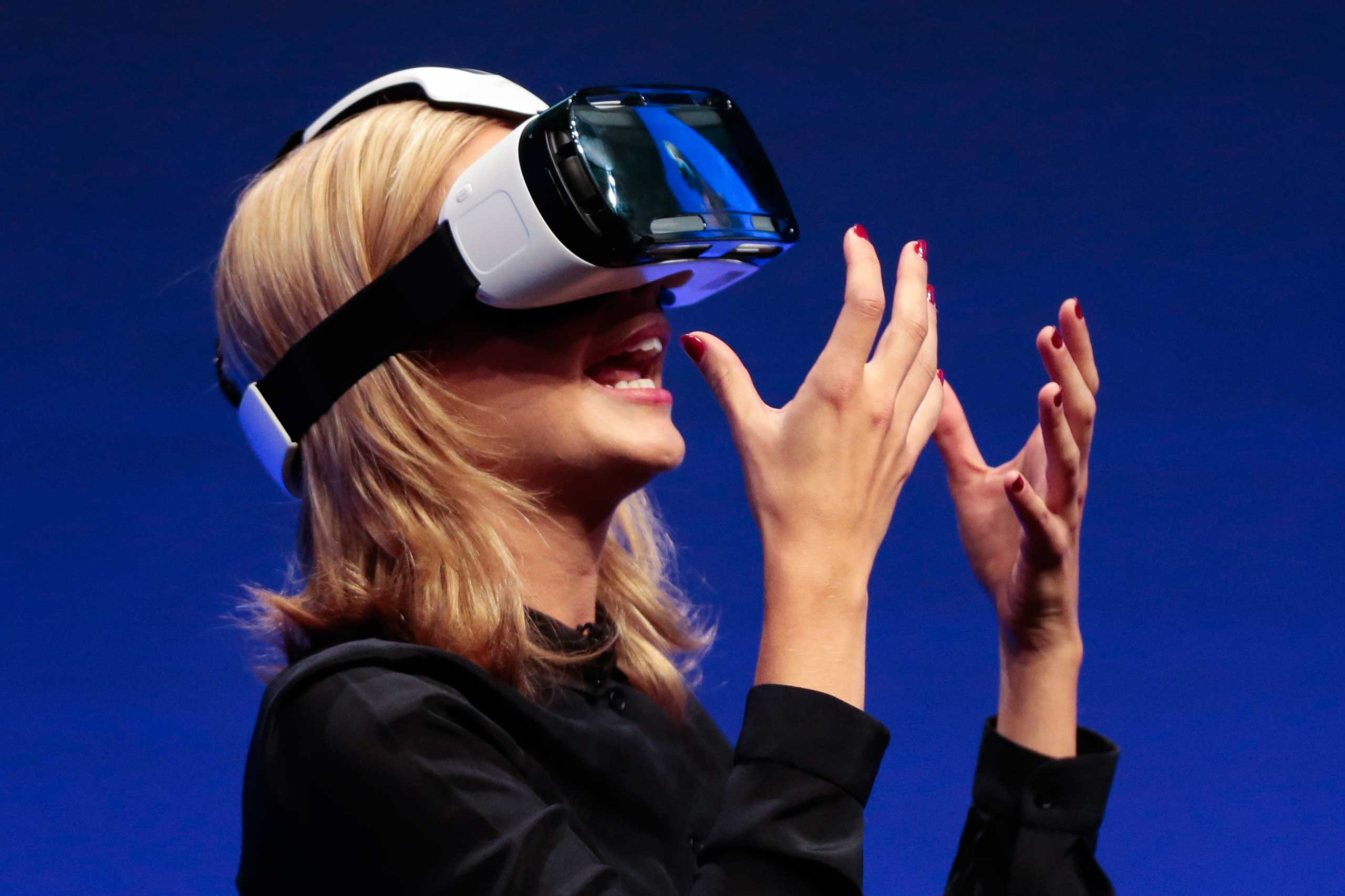2014                                                              British television presenter Rachel Riley showed a virtual-reality headset called Gear VR during a Samsung event ahead of the consumer electronic fair IFA in Berlin.