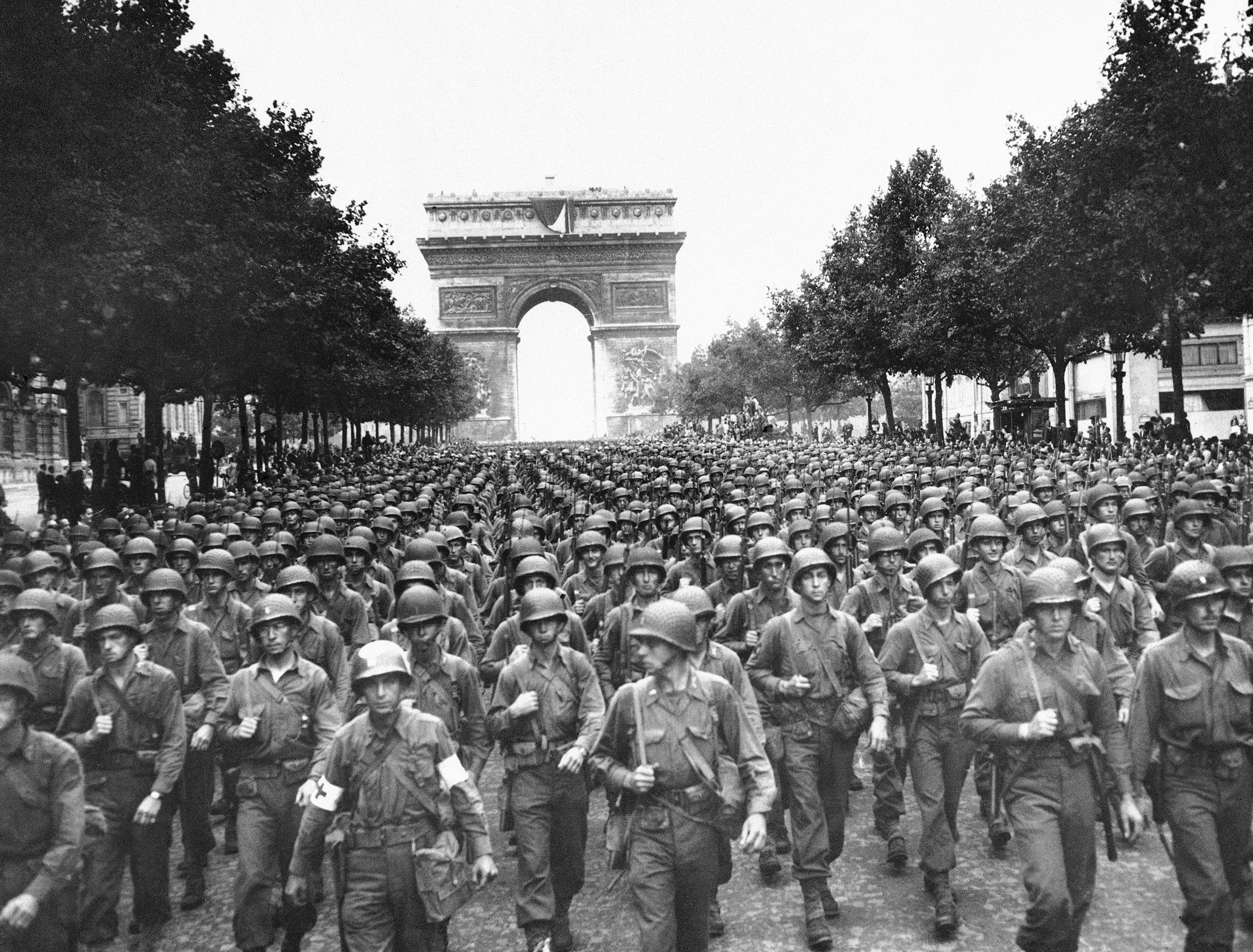 U.S. soldiers of Pennsylvania's 28th Infantry Division march along the Champs Elysees, the Arc de Triomphe in the background, on Aug. 29, 1944, four days after the liberation of Paris during WWII.