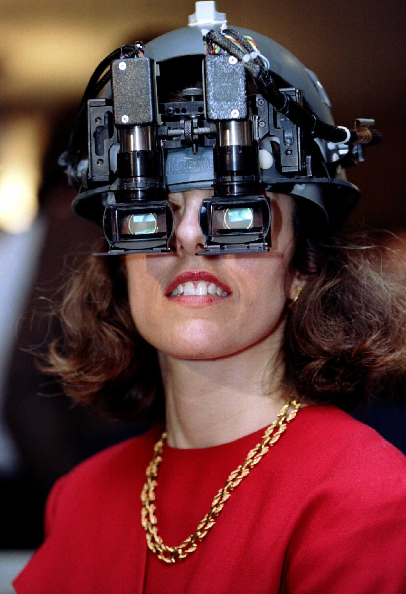 1995                                                              A visitor checking out a virtual reality head-set at the G7 Information Society Showcase taking place at the European Parliament. The head-set was linked to a camera elsewhere in the building which the visitor could control through head movements.