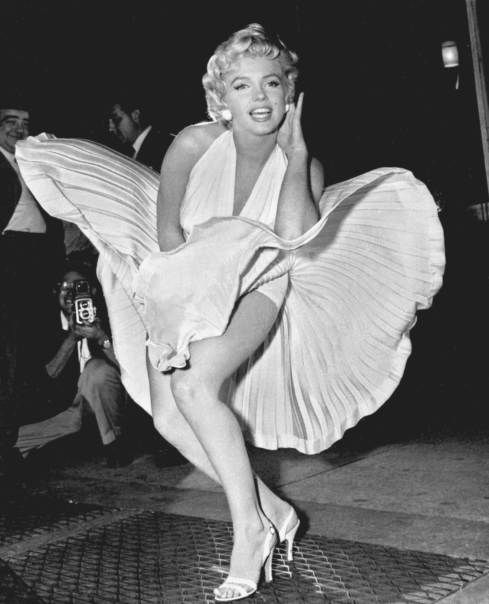 Marilyn Monroe poses over the updraft of New York subway grating while in character for the filming of The Seven Year Itch in New York City on Sept. 15, 1954.