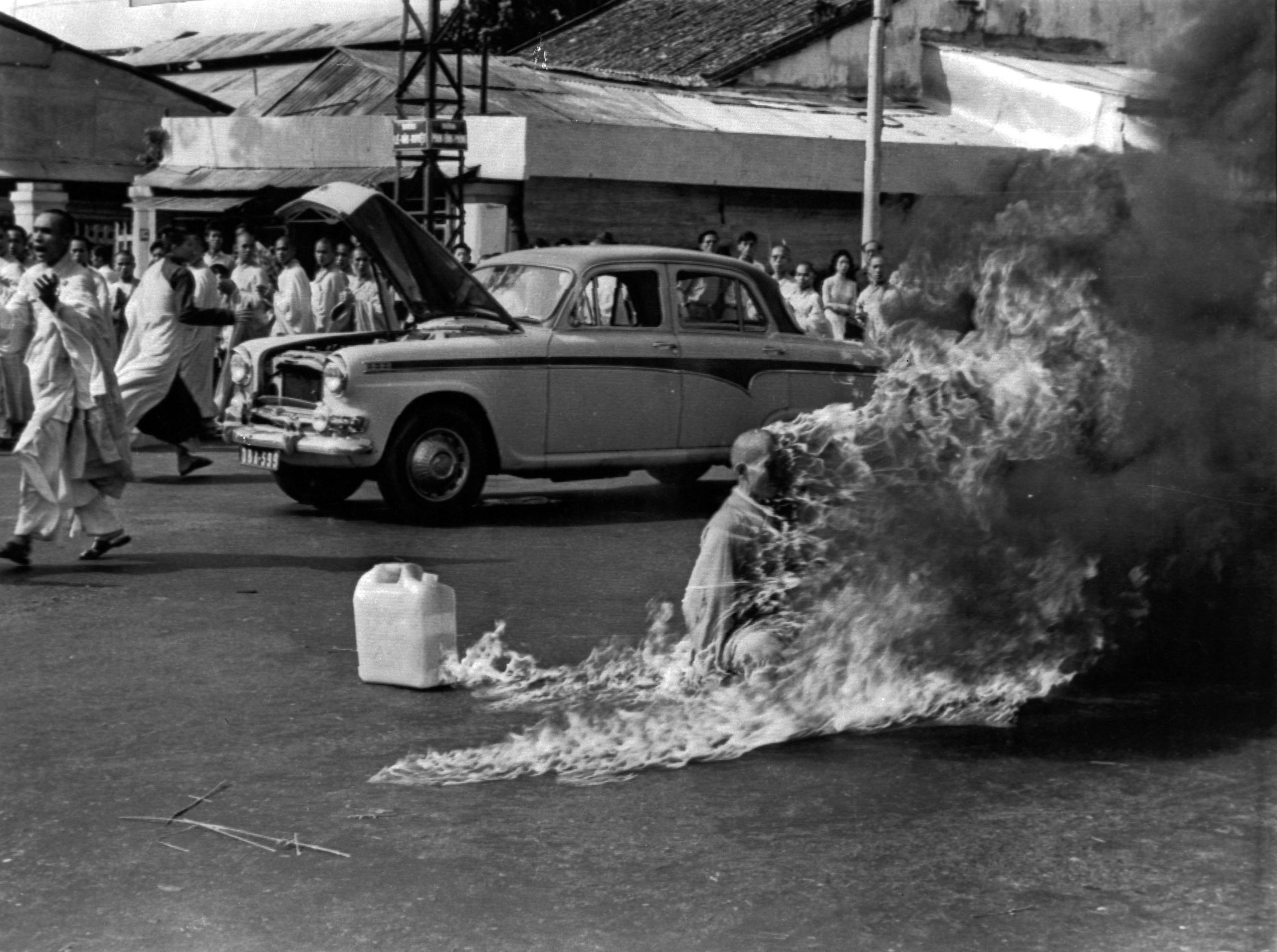 The Reverend Thich Quang Duc, a 73-year-old Buddhist monk, is soaked in petrol before setting fire to himself and burning to death in front of thousands of onlookers at a main highway intersection in Saigon on June 11, 1963.