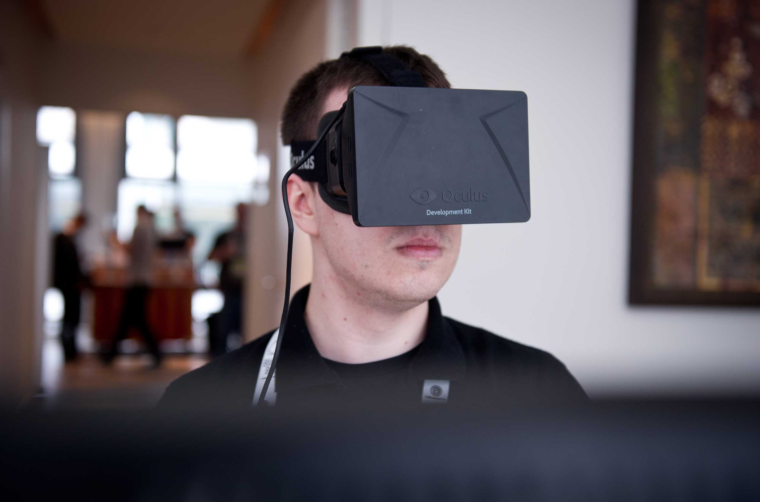 2014                                                              A man played a game with the virtual reality head-mounted display 'Oculus Rift' at International Games Week in Berlin. The display transfers the eye movements to the game in real time.