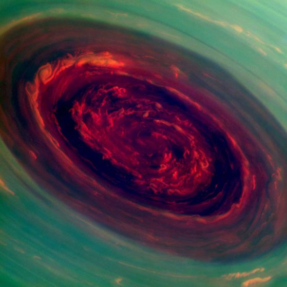 The vortex of Saturn's north polar storm is seen in this false-color image taken from NASA's Cassini spacecraft. The eye is an estimated 1,250 miles across with cloud speeds as fast as 330 miles per hour.