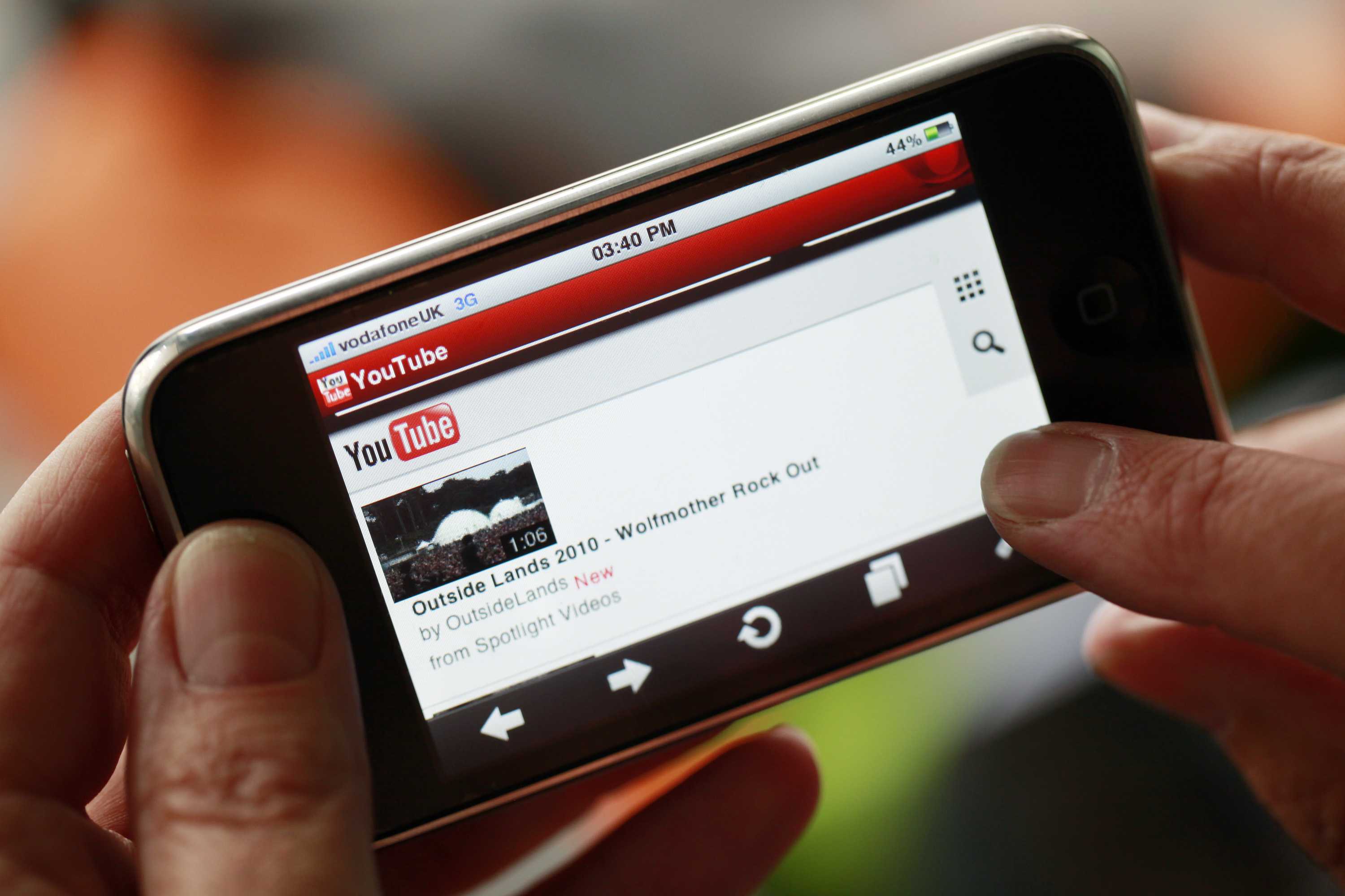 A businessman browses Google Inc.?s YouTube website using an Apple iPhone, made by Apple Inc., in this arranged photograph in London, U.K., on Thursday, Aug.19, 2010.