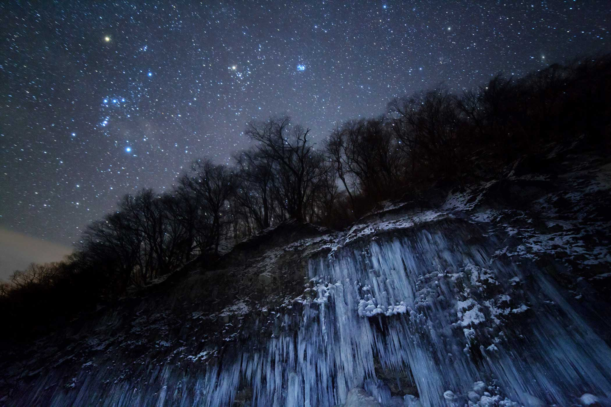 Taken in Nagano, Japan, this image shows Orion, Taurus and the Pleiades as the backdrop to an eerie frozen landscape. Though the stars appear to gleam with a cold, frosty light, bright blue stars like the Pleiades can be as hot as 30,000 degrees Celsius.