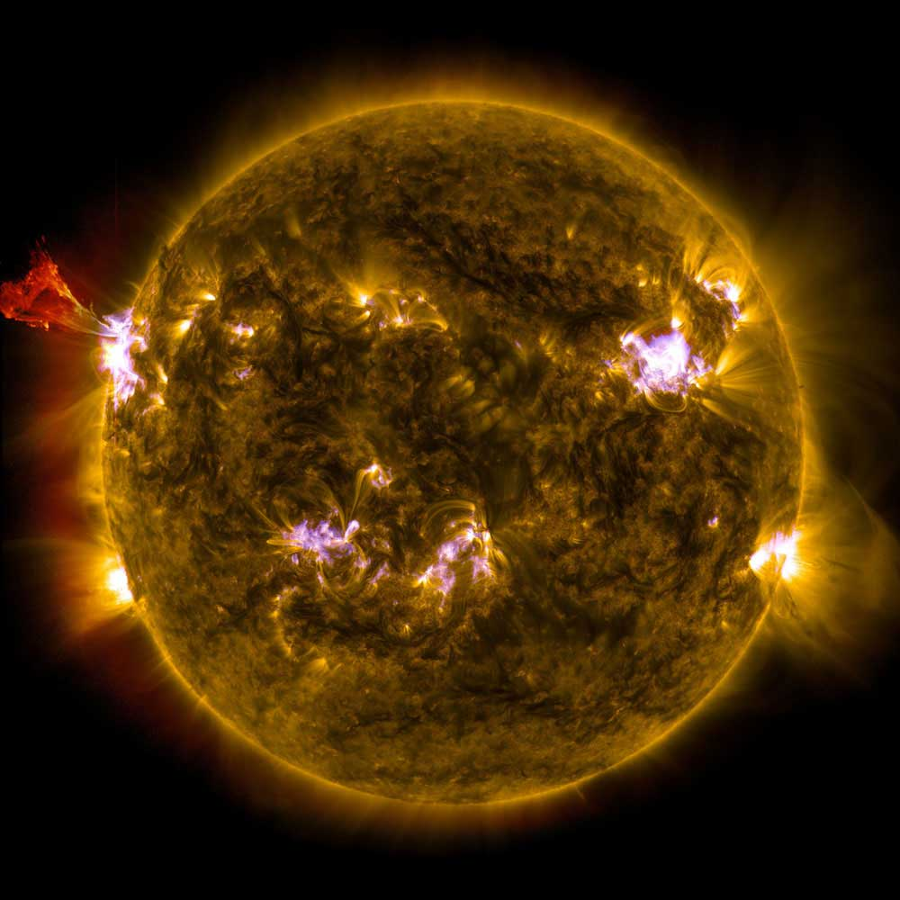 A burst of material leaps off the left side of the sun in what's known as a prominence eruption. This image combines three images from NASA's Solar Dynamics Observatory captured on May 3, 2013, at 1:45 pm EDT.
