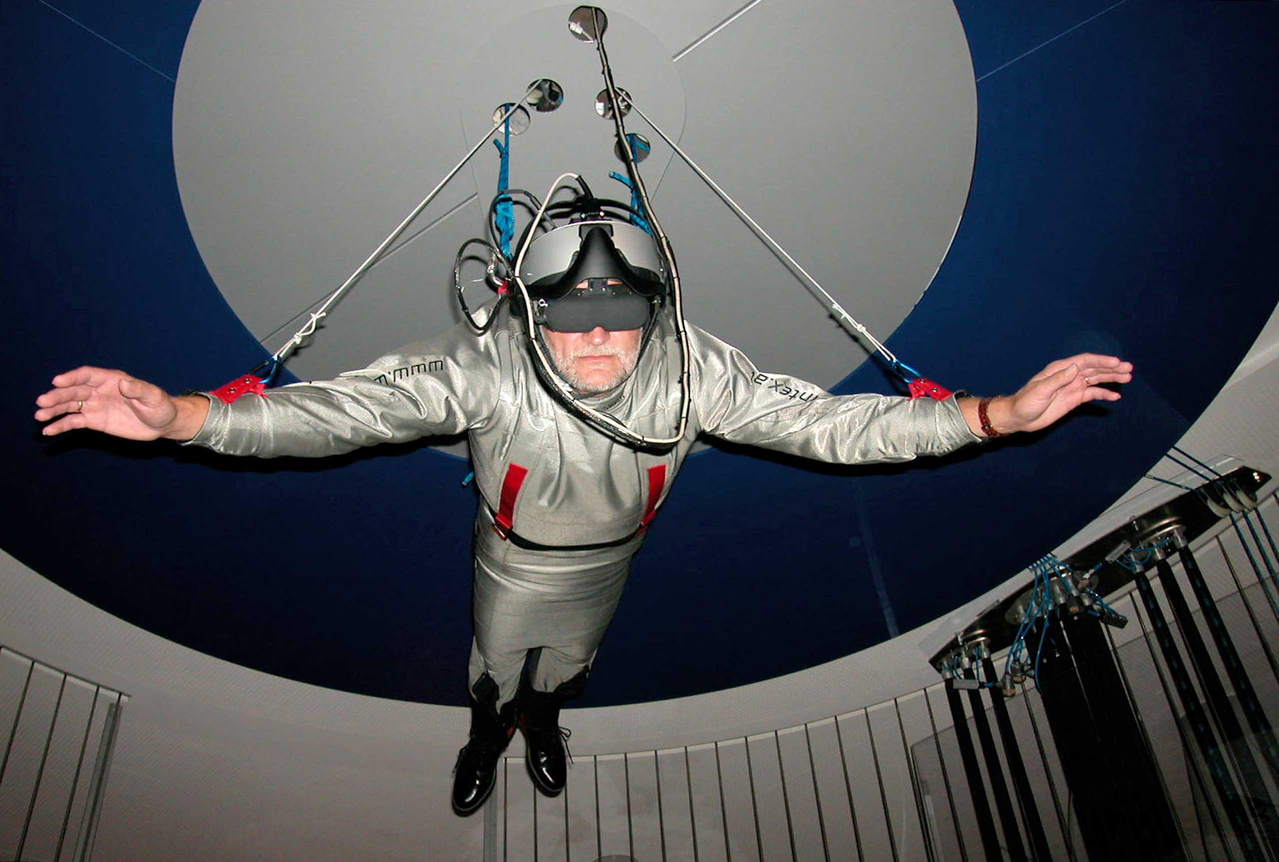 2003                                                              A visitor to the   Ars Electronica in a dish installation   Humphrey II  , which allowed virtual free flight through a 3D reconstruction of the city of Linz.