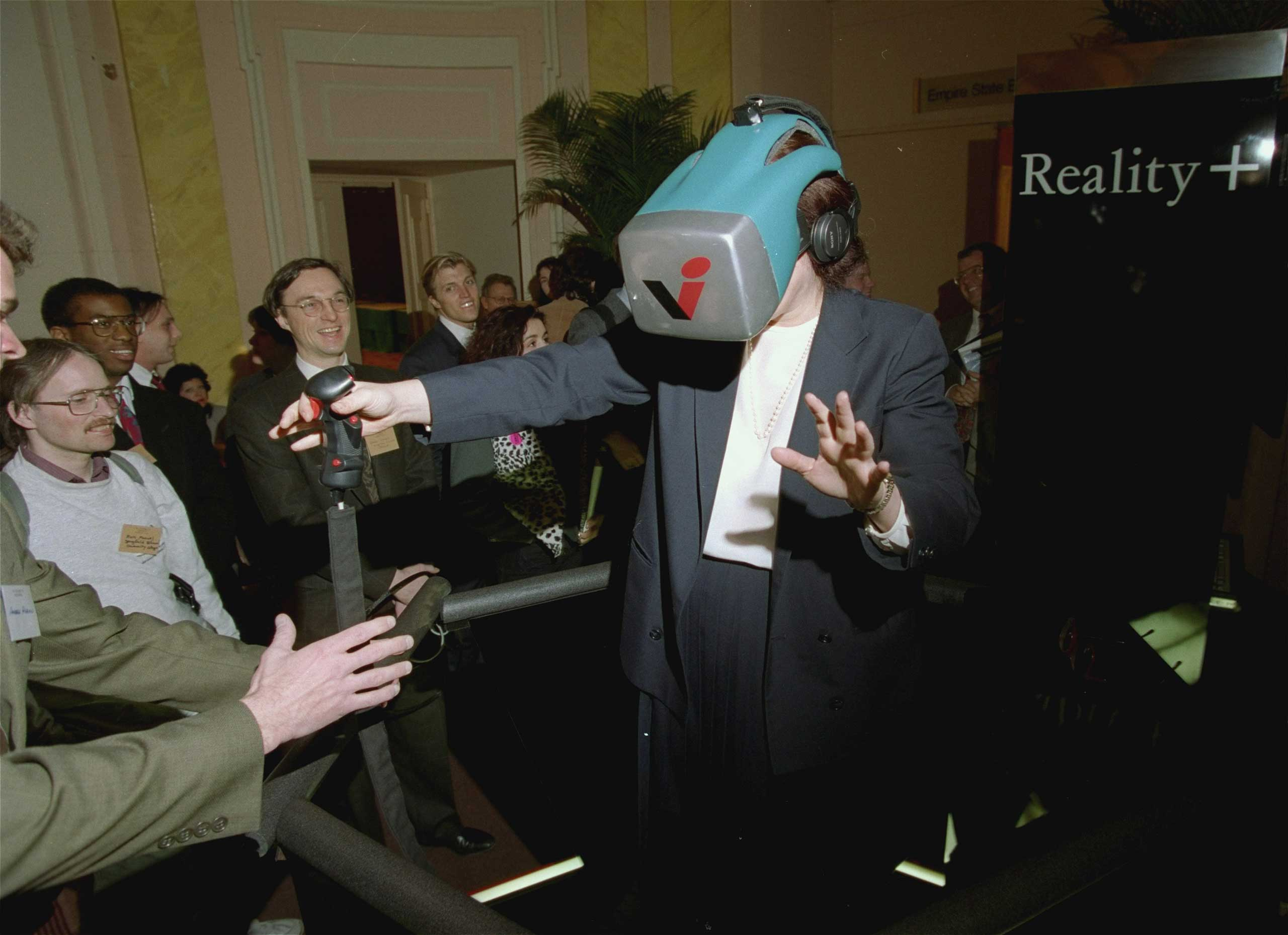 1993                                                               Reality +  at the Virtual Reality Systems 93 show was described as a next generation, multi-player virtual reality entertainment system that gave a high sense of movement in a computer-generated world revealed in a head-mounted display.