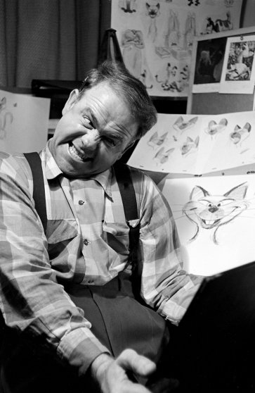 A Disney animator peers in a mirror to get facial expressions just right.
