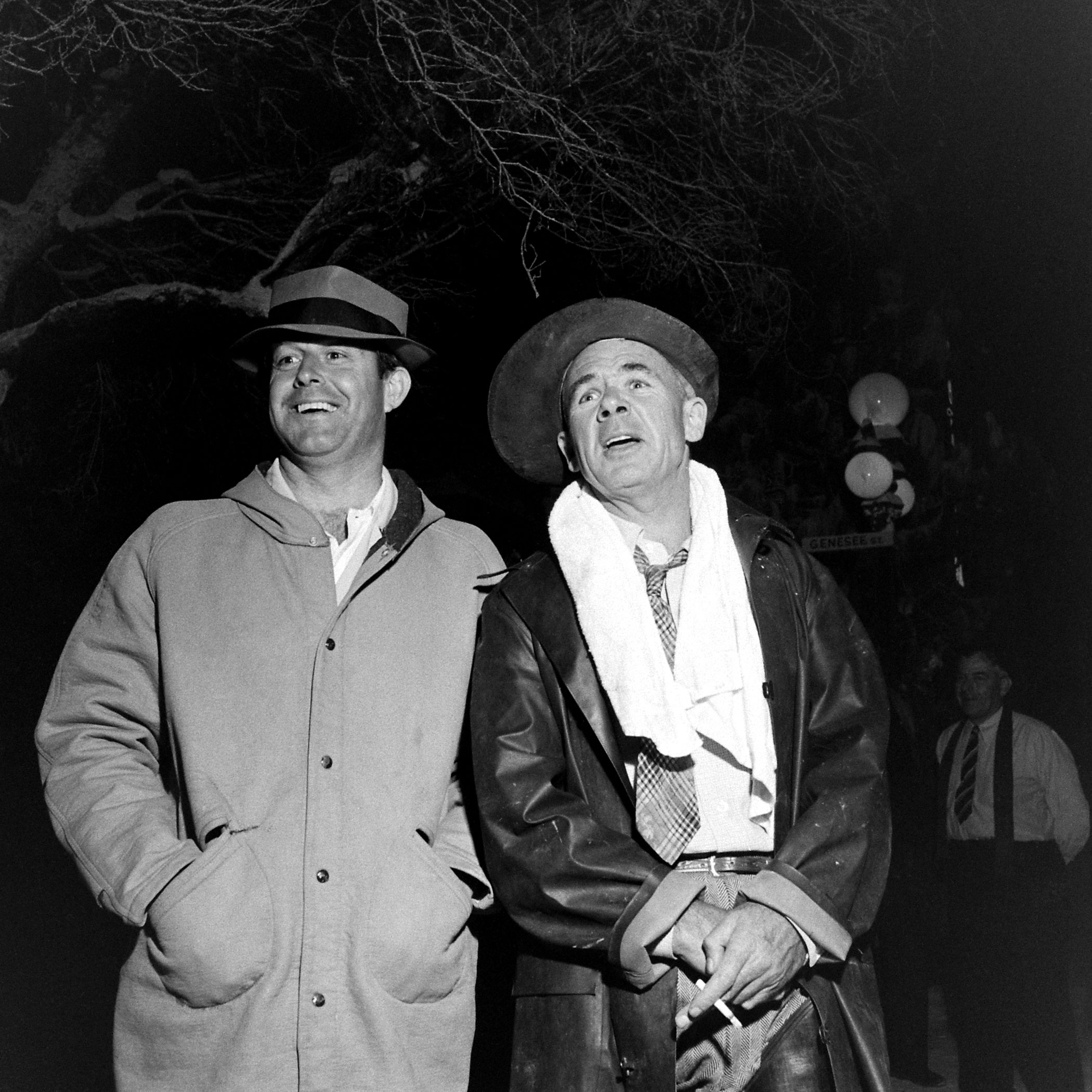 <b>Not published in LIFE.</b> Director Frank Capra (right, with unidentified man) on the set of <i>It's a Wonderful Life</i>.