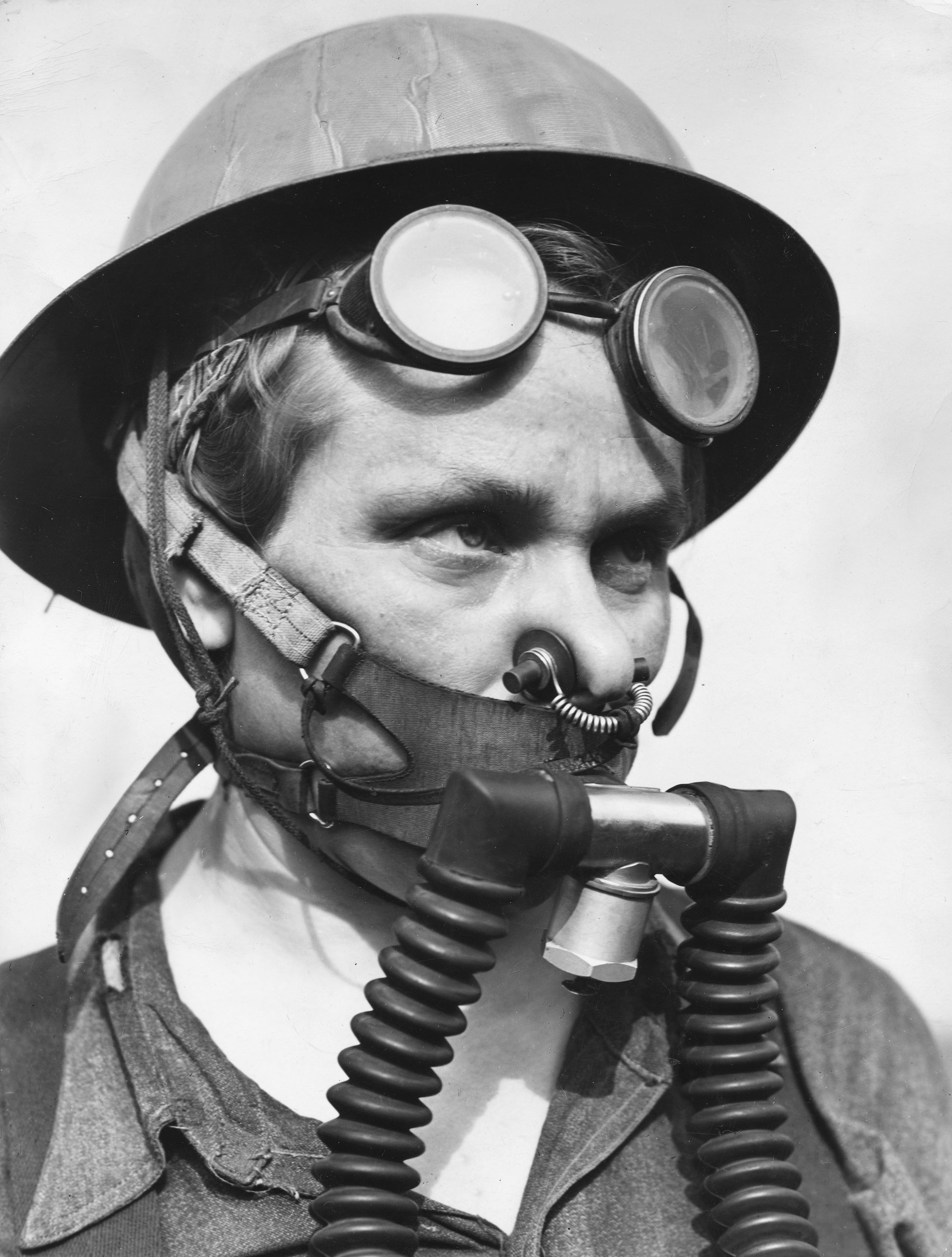 "Bernice Daunora, 31, a member of a steel mill's ""top gang"" who must wear a ""one-hour, lightweight breathing apparatus"" as protection against gas escaping from blast furnaces, Gary, Ind., 1943."