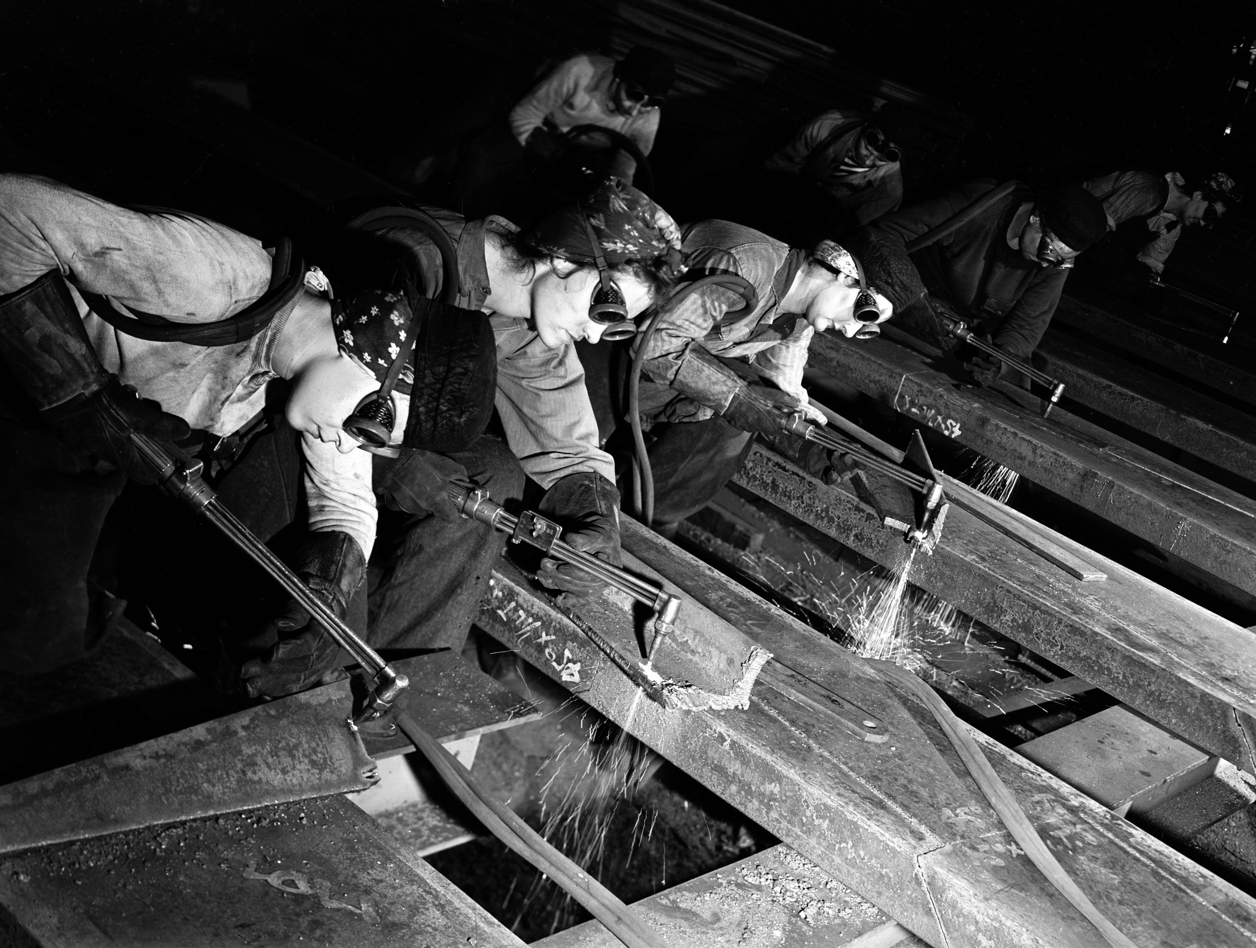 <b>Caption from LIFE.</b> Beveling armor plate for tanks at Gary Works, these women operate powerful acetylene torches.