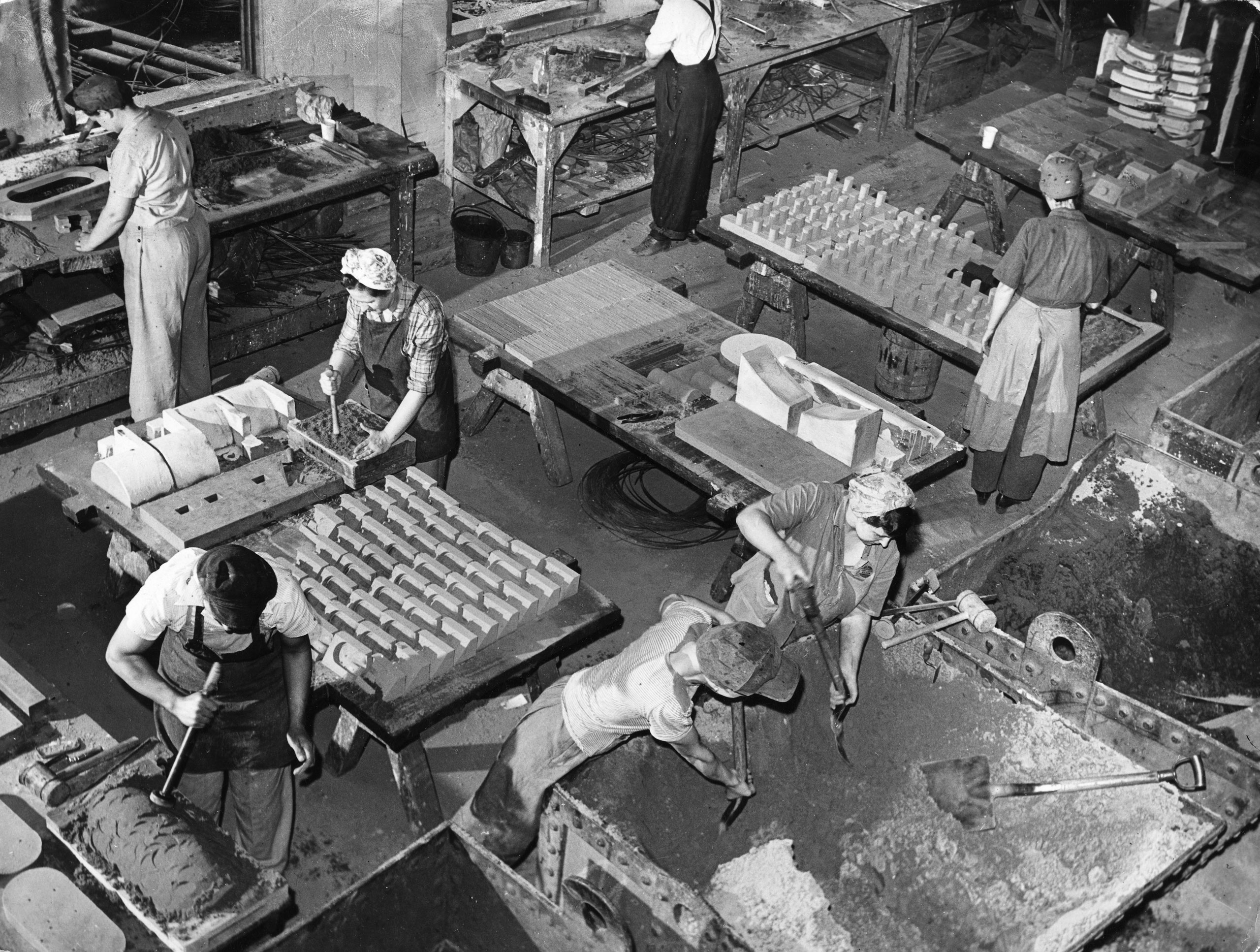 <b>Caption from LIFE.</b> In the foundry of the Carnegie-Illinois Steel Co., these women are at work as core-makers. A total of 18 women employed here on two shifts. The core-maker's functions are like those of a sculptor, and the implements used are trowels, spatulas and mallets. Castings being made in this picture are for use not only at Carnegie-Illinois but at other plants.