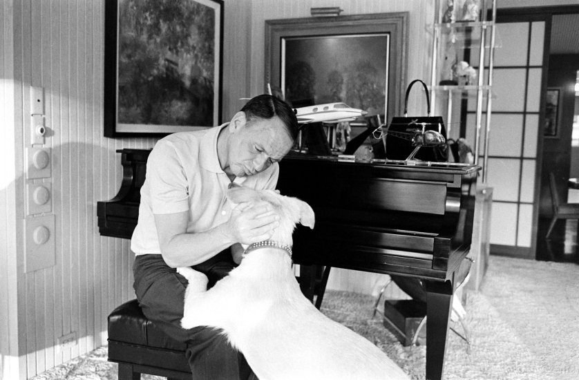 Frank Sinatra and his dog, Ringo, at Sinatra's home in Palm Springs, California, in 1965.