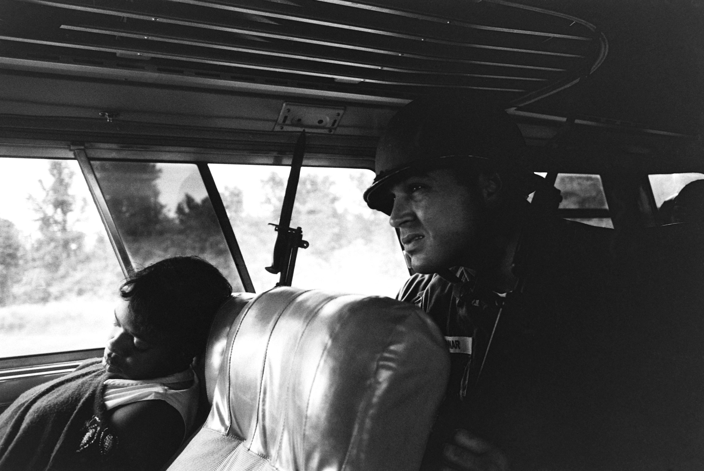 A freedom rider and member of the National Guard on a bus in the Deep South.