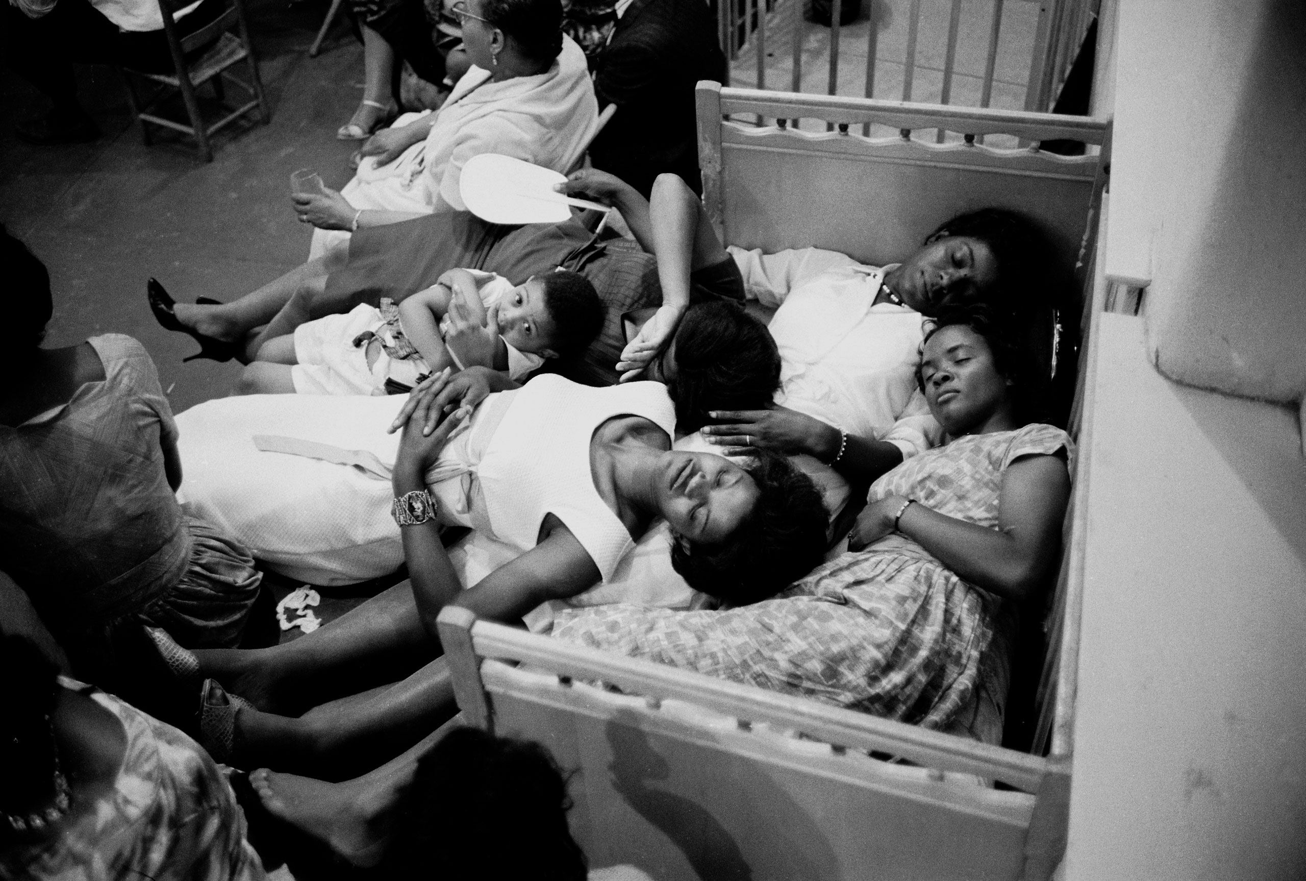 Freedom riders try to rest at the Rev. Ralph Abernathy's First Baptist Church in Montgomery, Ala., as a white mob gathers outside.