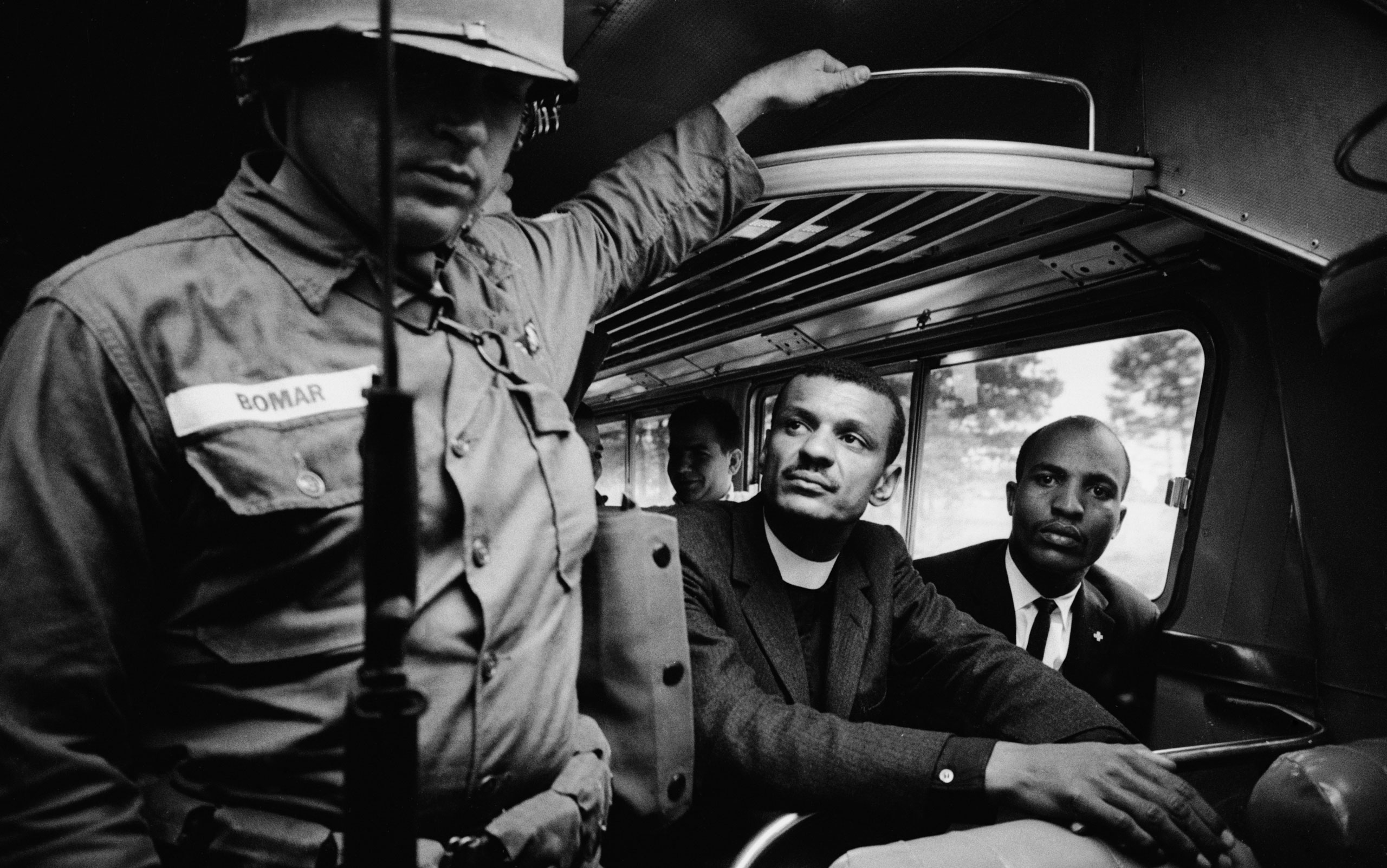 Freedom riders and members of the National Guard on a bus in the Deep South.