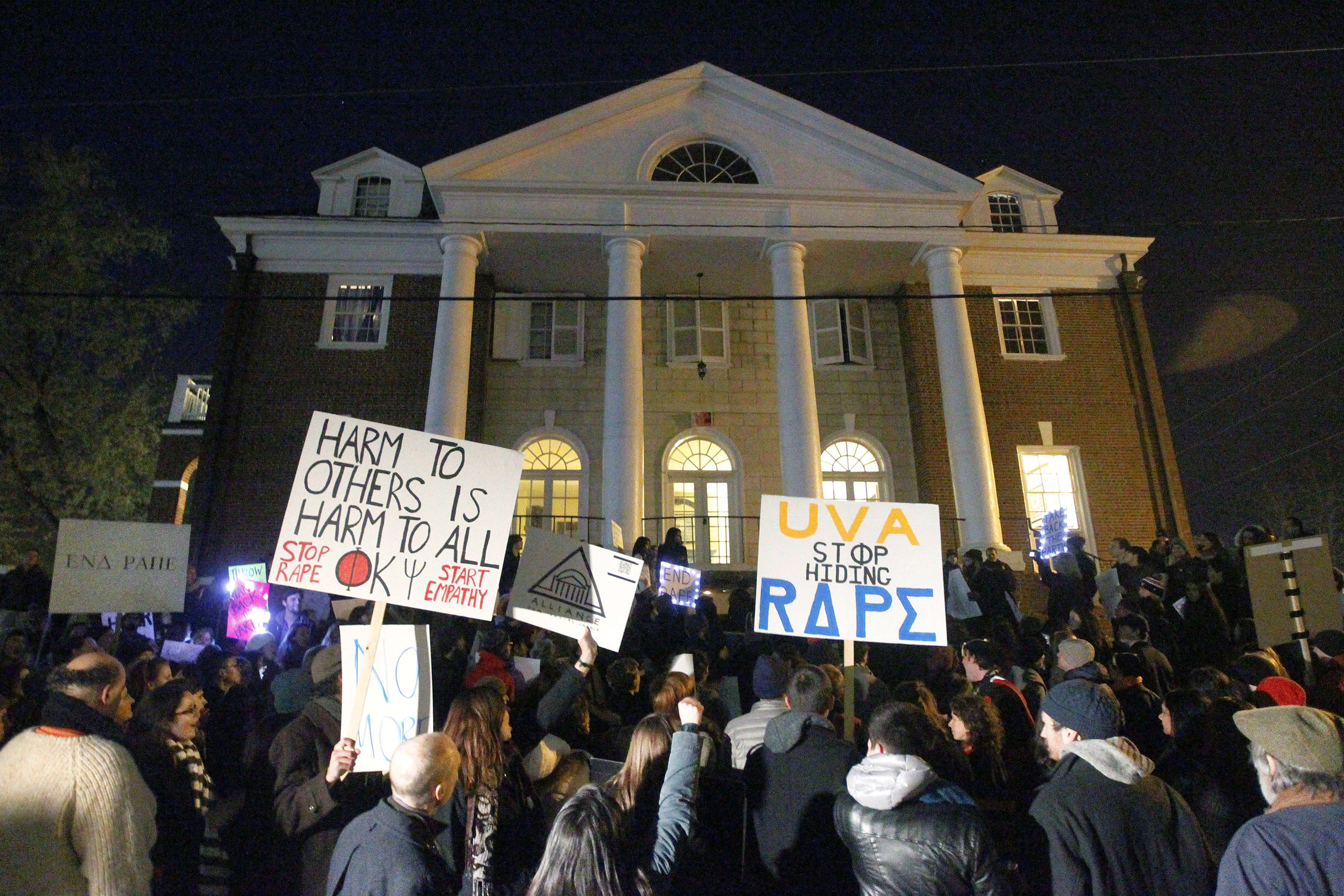 Protesters gather in front of the Phi Kappa Psi fraternity house at the University of Virginia on Nov. 22