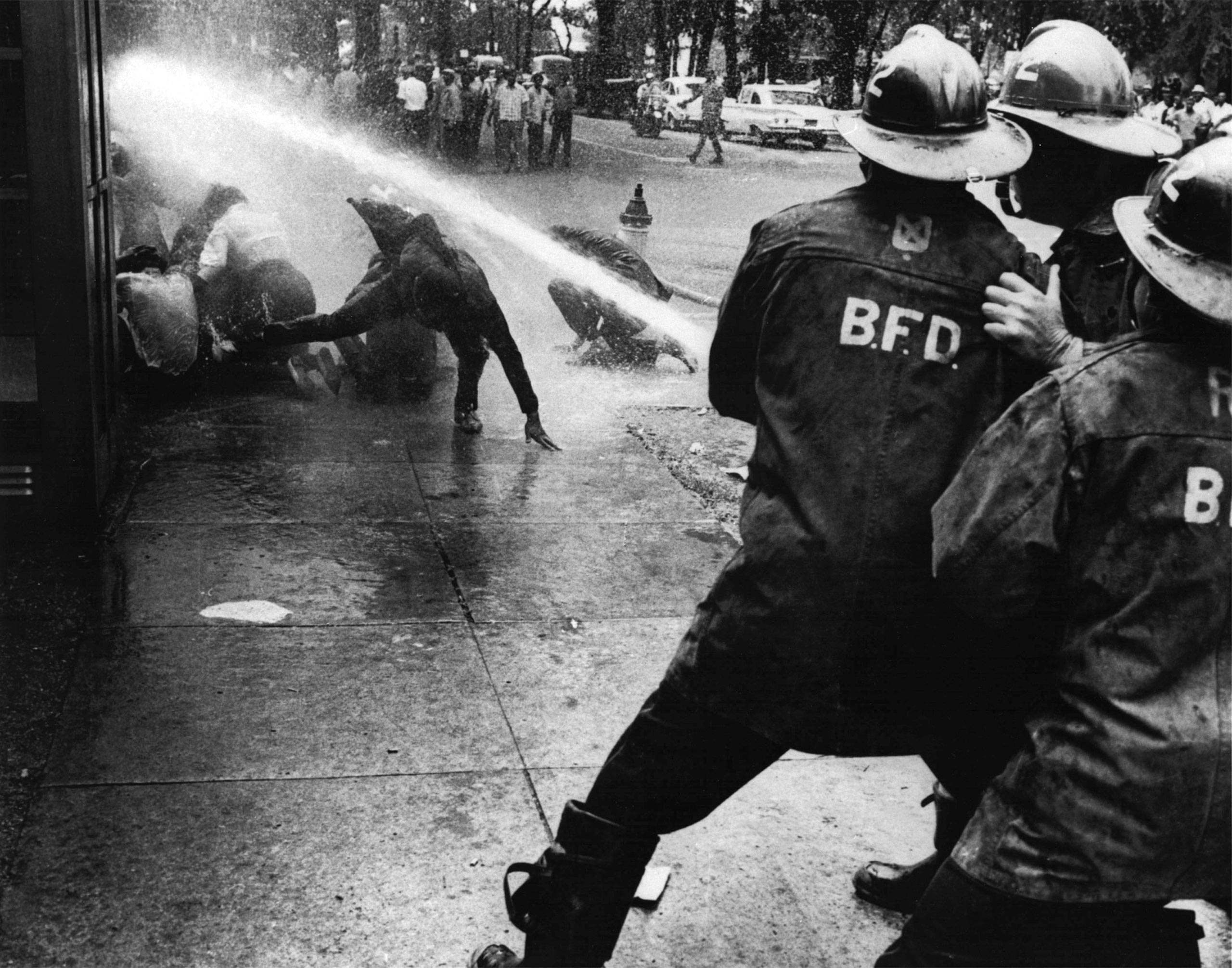 Firefighters turn their hoses full force on civil rights demonstrators in Birmingham, Ala., on July 15, 1963