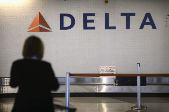 A passenger waits for her luggage in the Delta baggage claim at O'Hare International Airport in Chigcago on Oct. 24, 2012