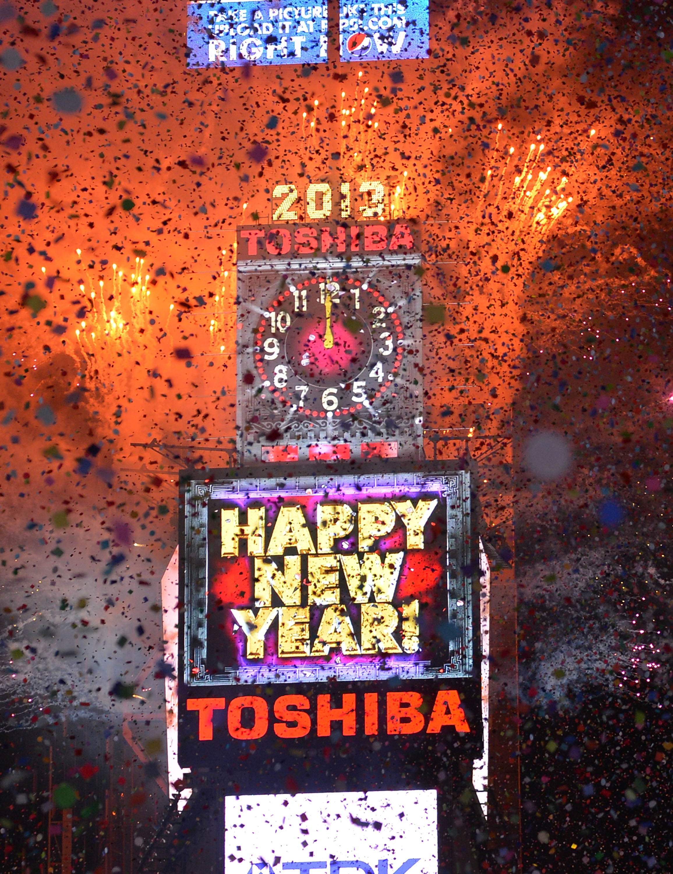 A view of atmosphere during New Year's Eve 2013 In Times Square at Times Square on December 31, 2012 in New York City.