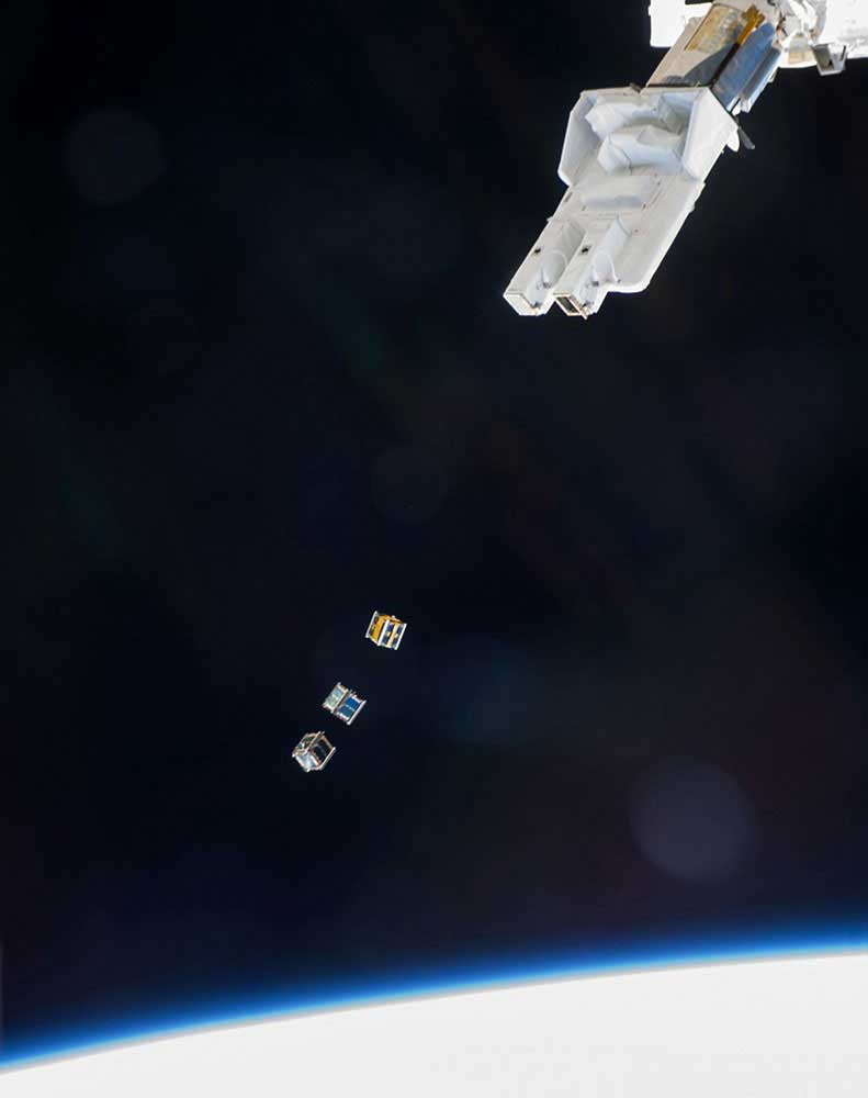 Three nanosatellites, known as Cubesats, are deployed on Nov. 19, 2013 from a Small Satellite Orbital Deployer (SSOD) attached to a robotic arm on the International Space Station.