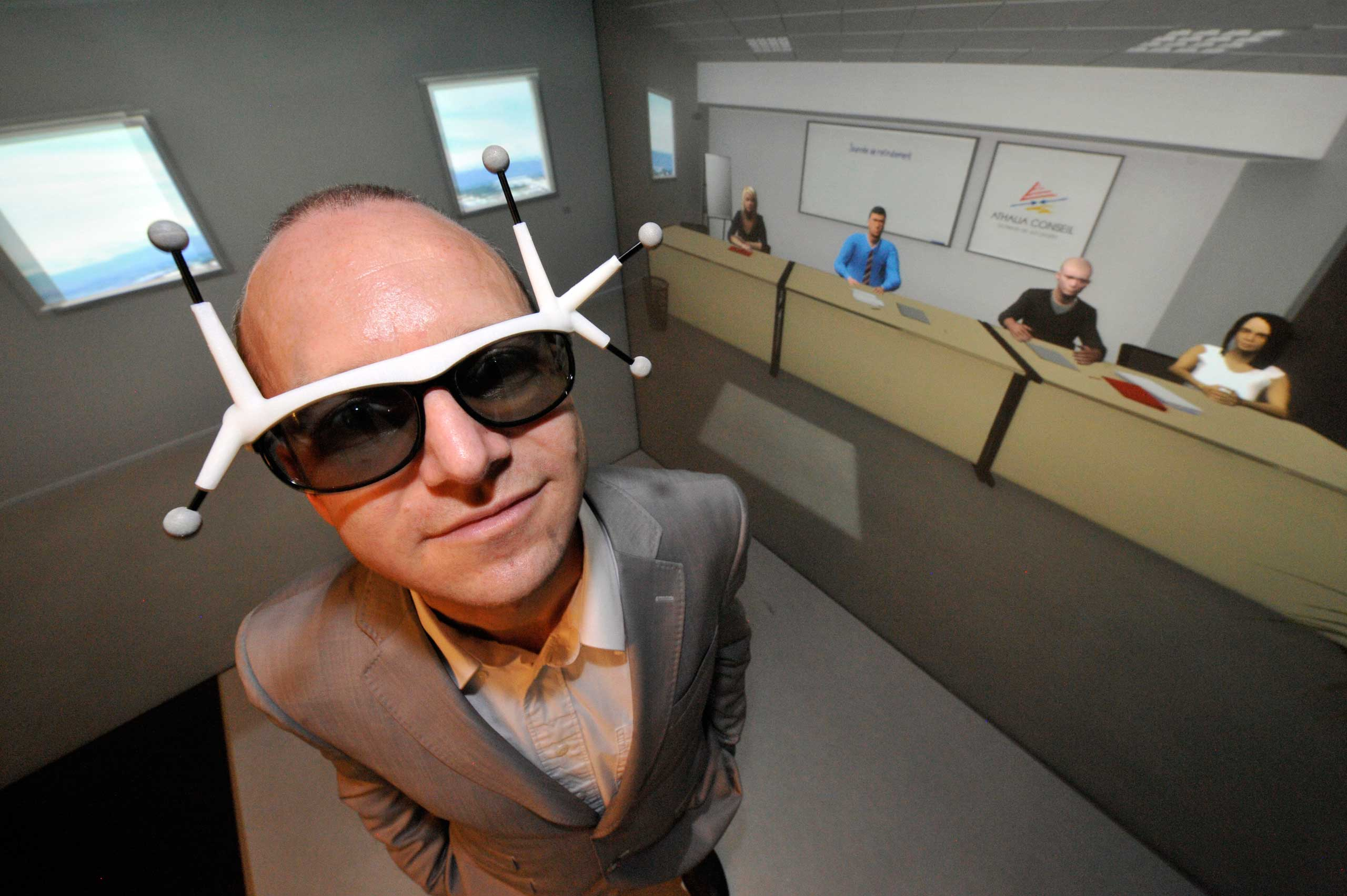 2012                                                              A man seeking a job was equipped with 3D spectacles with sensors as he trained in Clermont-Ferrand, central France with avatars (background) in a virtual reality cube, at business incubator Pascalis.