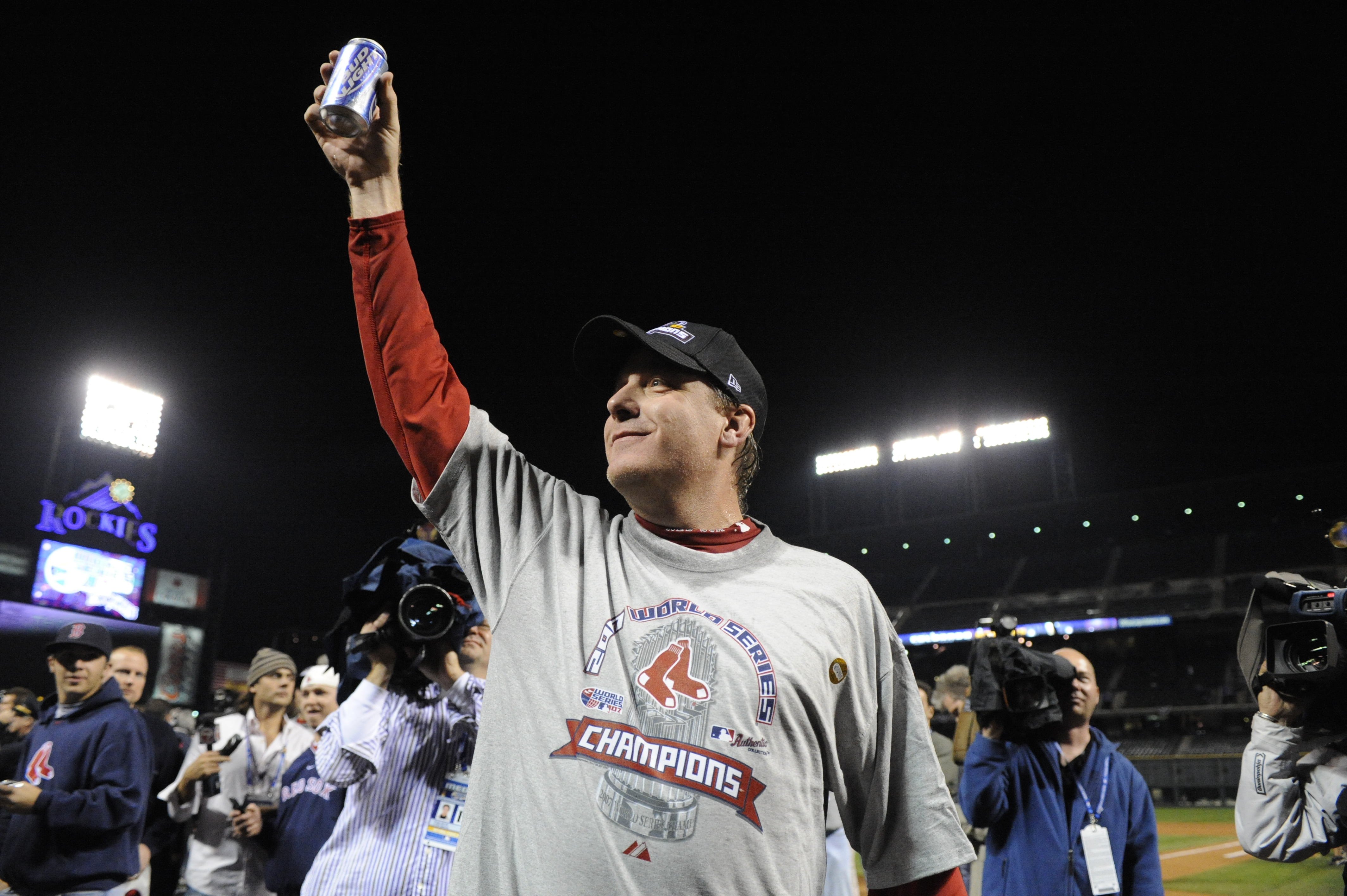 Red Sox Pitcher Curt Schilling holds a beer to the crowd, mostly Red Sox fans after the Sox won the series 4-0.