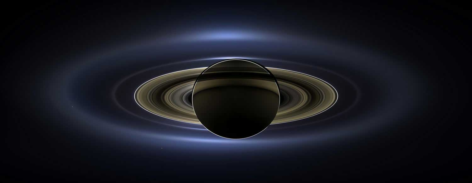On July 19, 2013, NASA's Cassini spacecraft slipped into Saturn's shadow and photographed the planet and its rings, seven of its moons, and, in the background, the blue speck that is Earth. The image, released on obtained Nov. 13, 2013, was painstakingly assembled from 141 mosaic-like pieces. It spans about 404,880 miles (651,591 kilometers) from one side to the other.