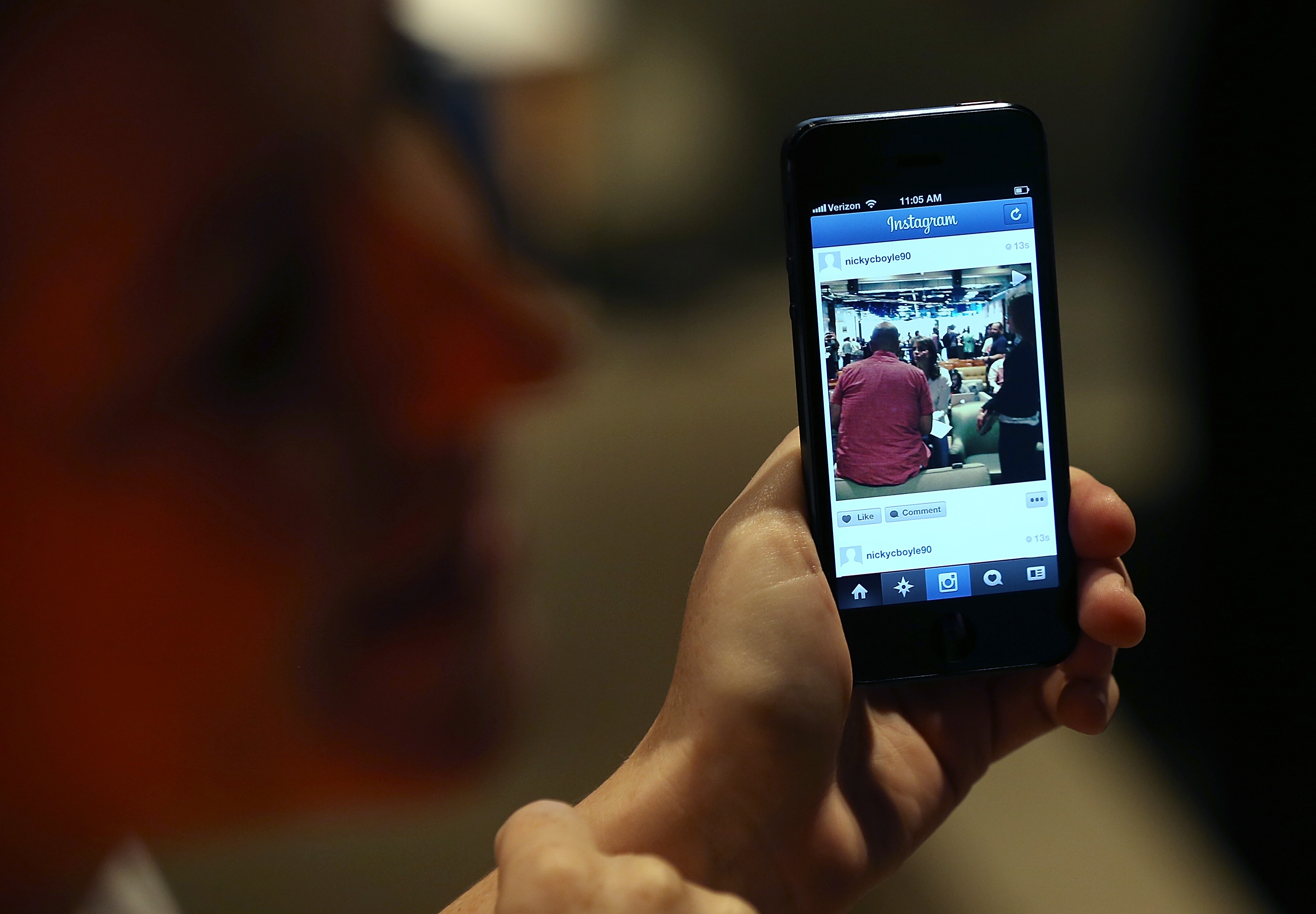 A Facebook employee demonstrates the new Instagram video option during a press event at Facebook headquarters on June 20, 2013 in Menlo Park, California.