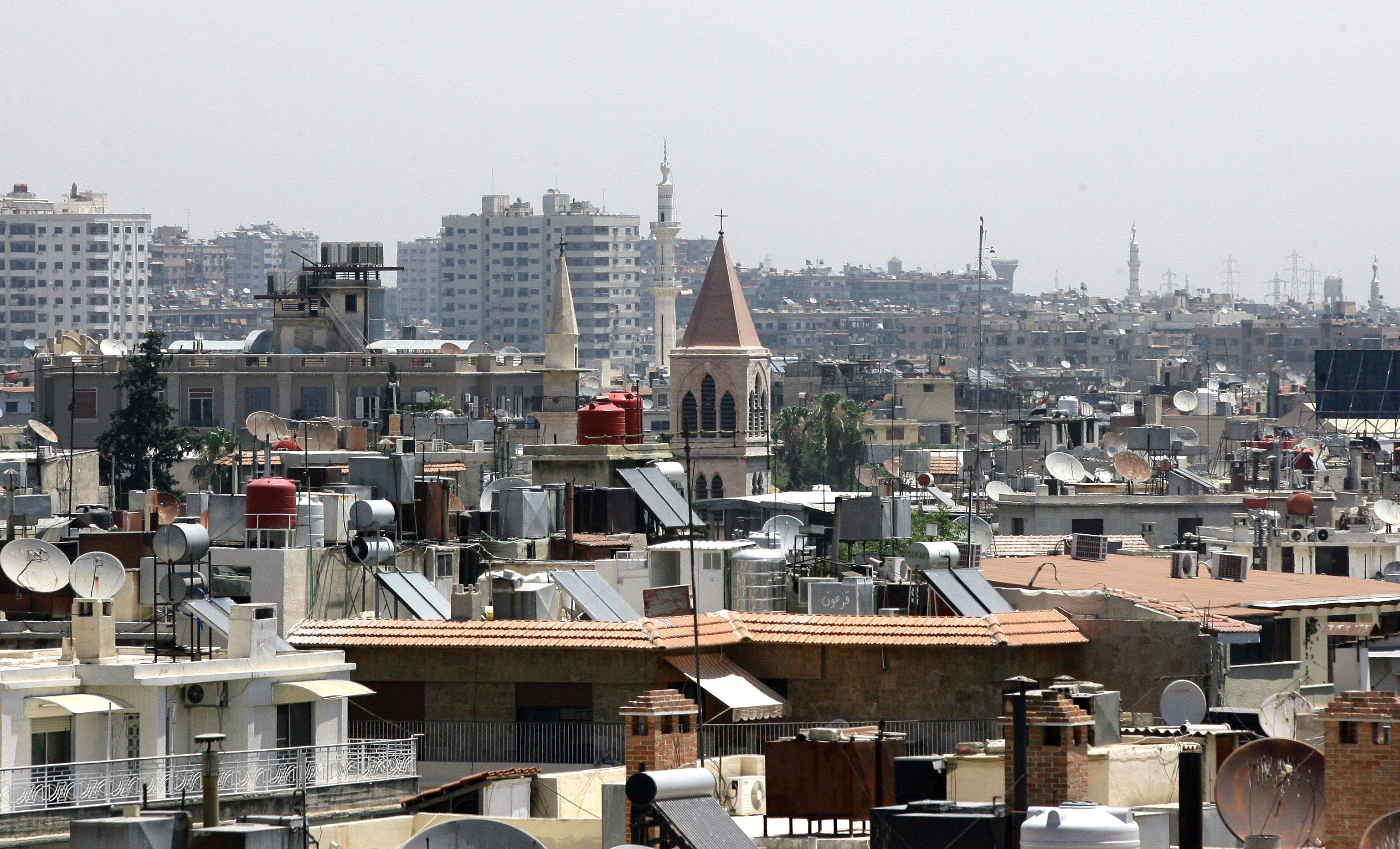 The minarets of mosques and the steeples of churches are seen towering above rooftops  in the Syrian capital, Damascus, on June 26, 2013
