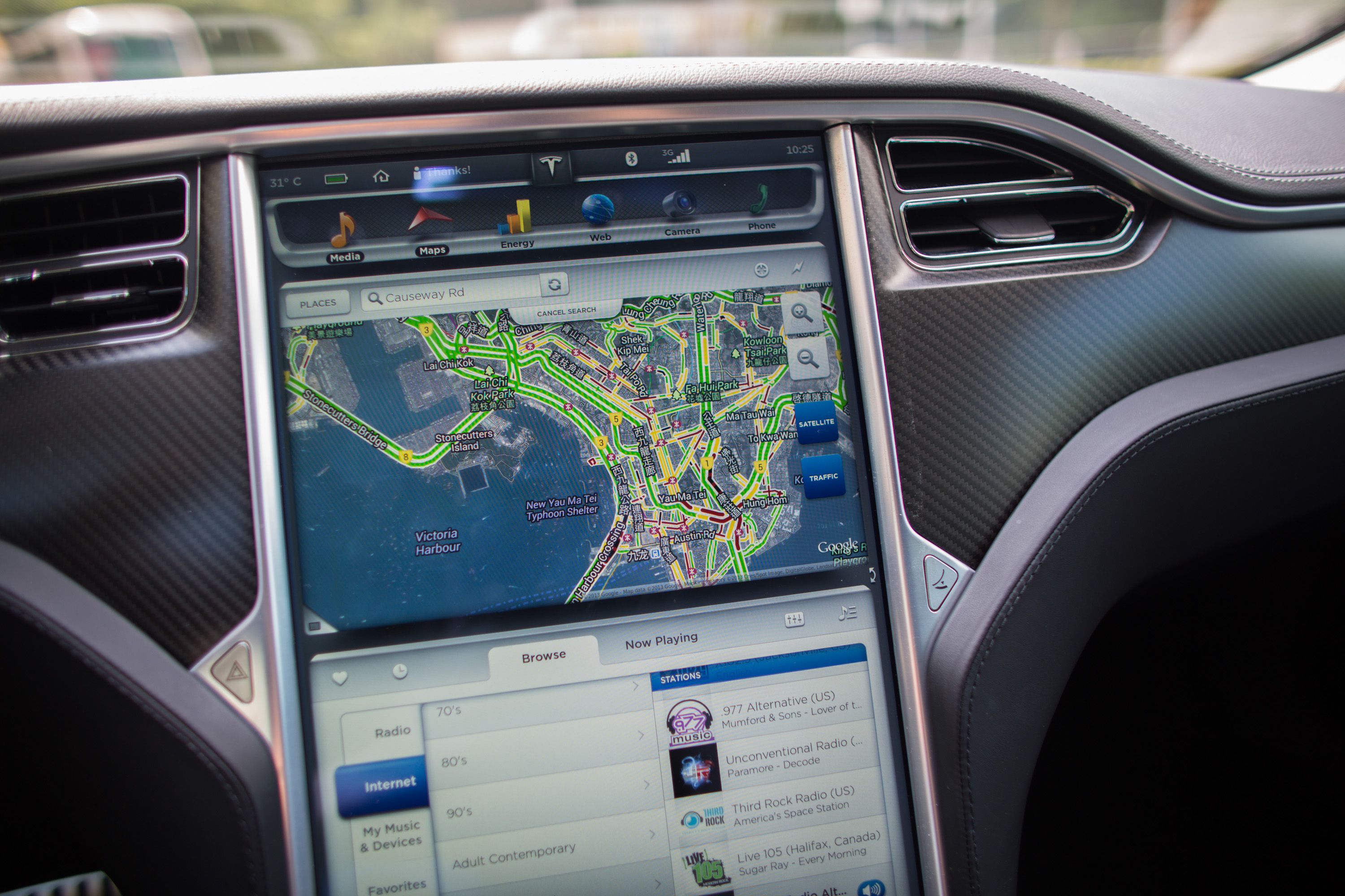 A Google Inc. map is displayed on a screen in a Tesla Motors Inc. Model S sedan electric vehicle (EV) parked in the area of Cyberport in Hong Kong, China, on Friday, July 5, 2013.