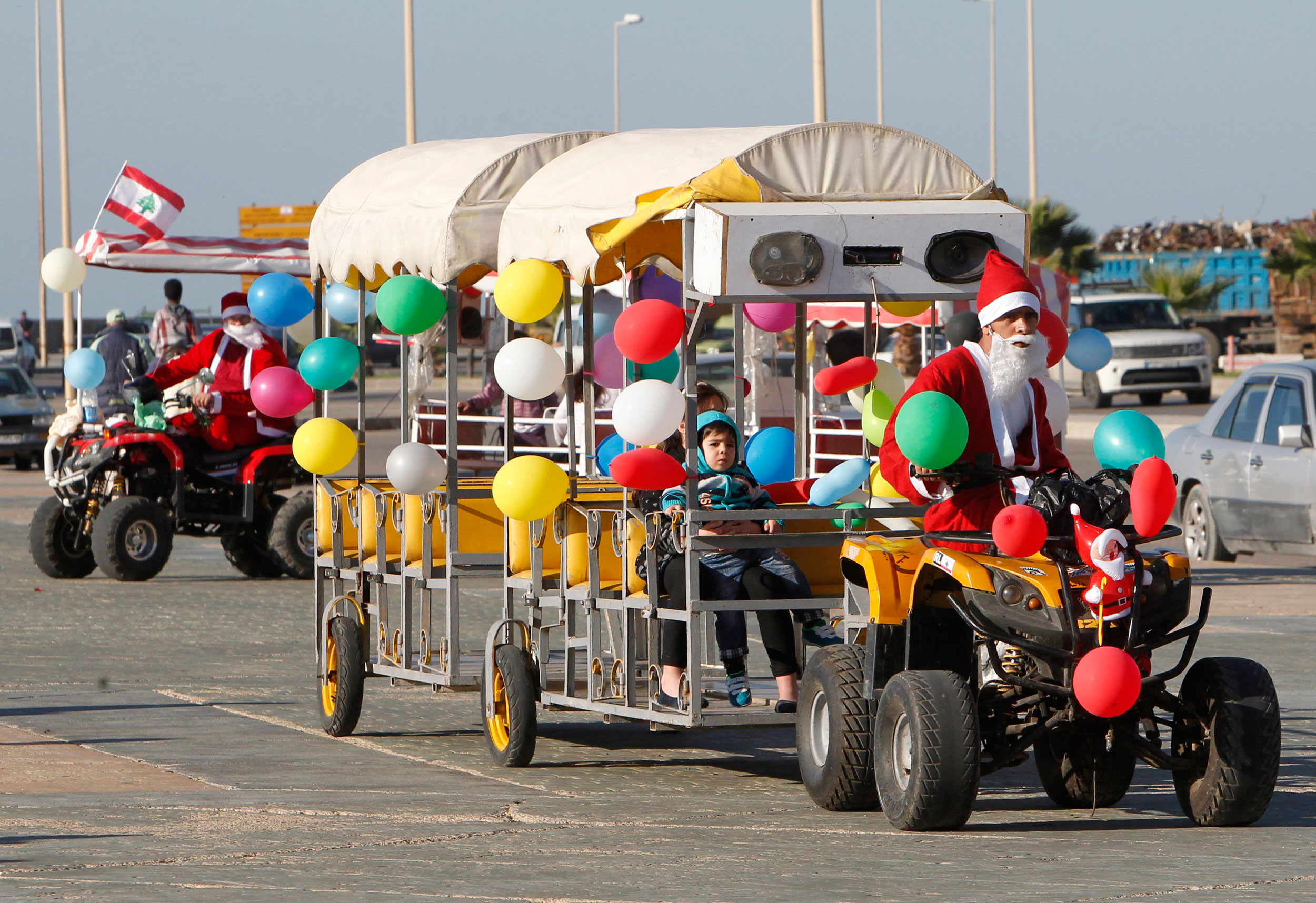 A man dressed as Santa Claus drives a vehicle during Christmas day in Sidon, South Lebanon on Dec. 25, 2014.