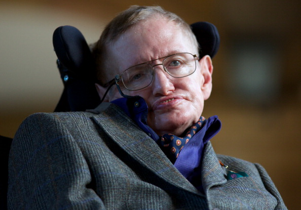 Theoretical physicist Stephen Hawking poses for a picture ahead of a gala screening of the documentary 'Hawking', a film about the scientist's life.
