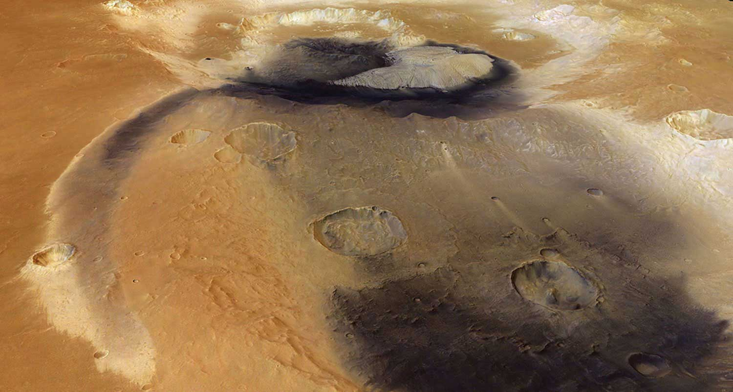 Prominent patches of wind-blown dust, possibly mixed with volcanic ash, radiate from Becquerel crater and into a neighboring crater on Mars. The streak of dust following a radial path likely traces a gentle topographic depression.