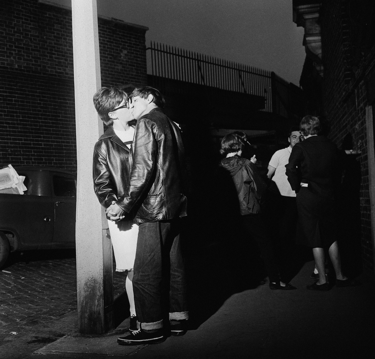 Young Mods kissing in the street in London, 1964