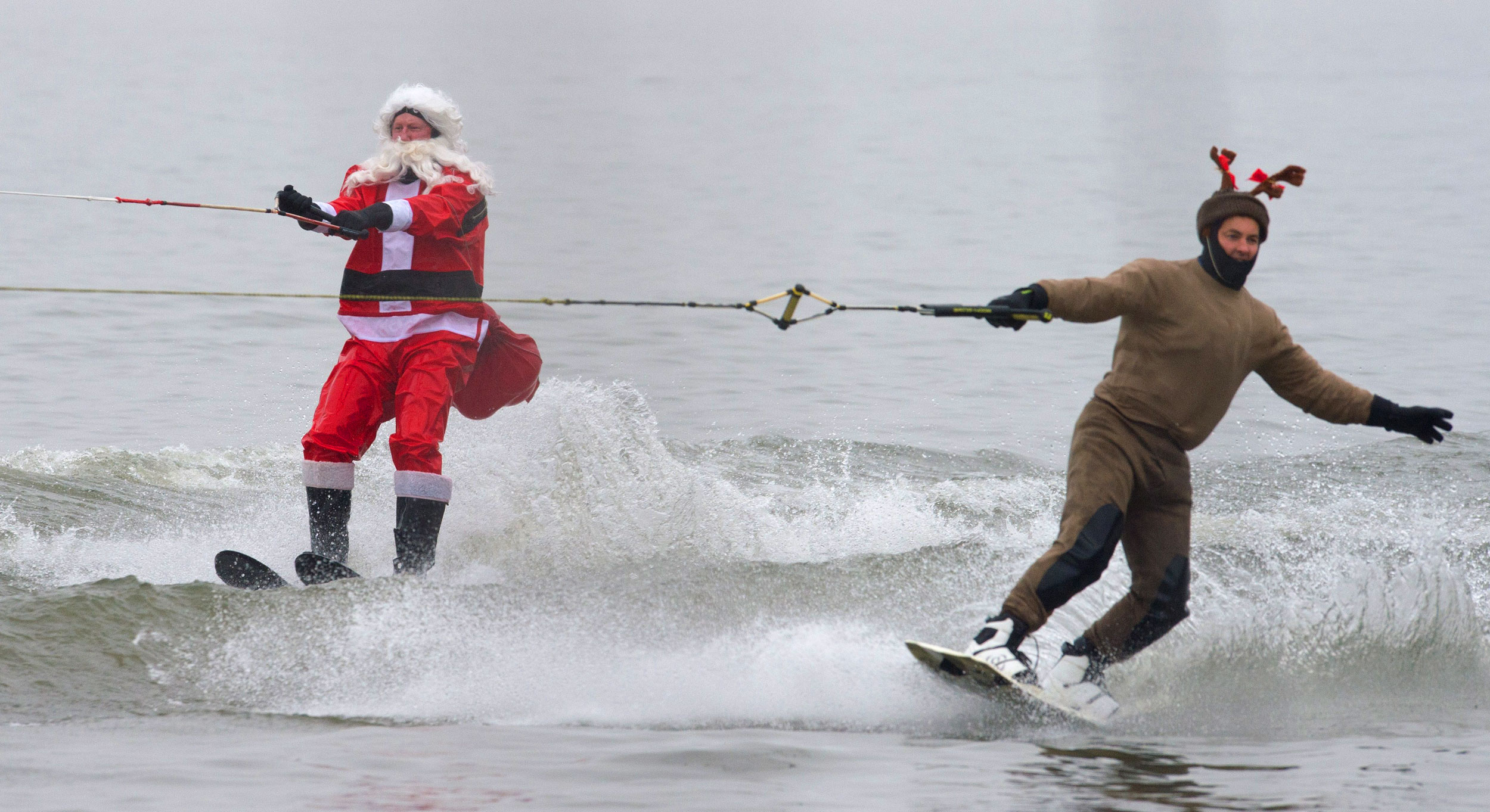 The water-skiing Santa and a Reindeer are seen along the Potomac River off Old Town Alexandria, Virginia, not far from Washington on Dec. 24, 2014 during the annual water-skiing Santa event.