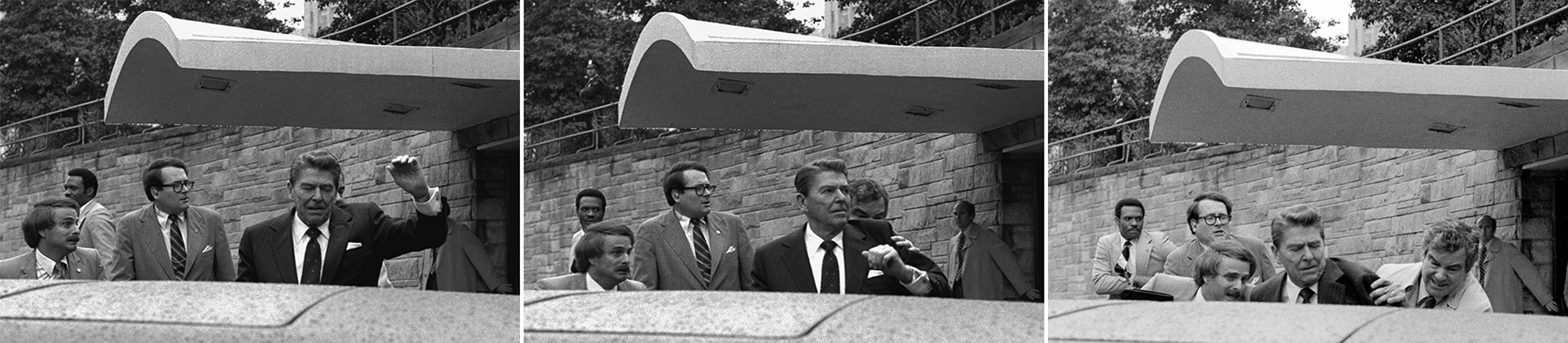 U.S. President Ronald Reagan raises his left arm as he is shot at by an assailant outside a hotel in Washington, D.C., on March 30, 1981.