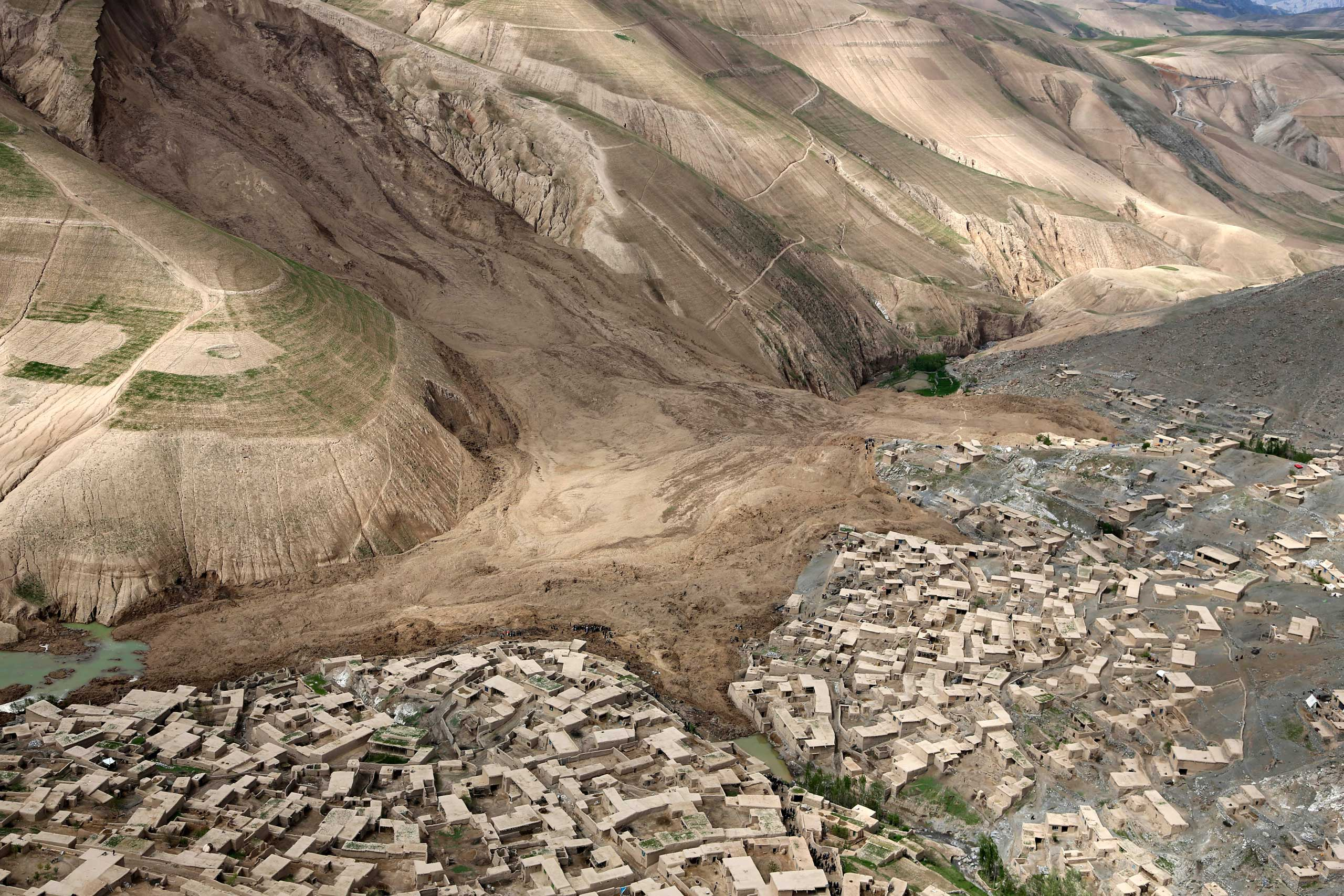 <b>Afghanistan Mudslide</b> An aerial view shows the site of a landslide that buried Abi Barik village in Badakhshan province, northeastern Afghanistan, May 5, 2014. Hundreds of people were killed and 700 families displaced.