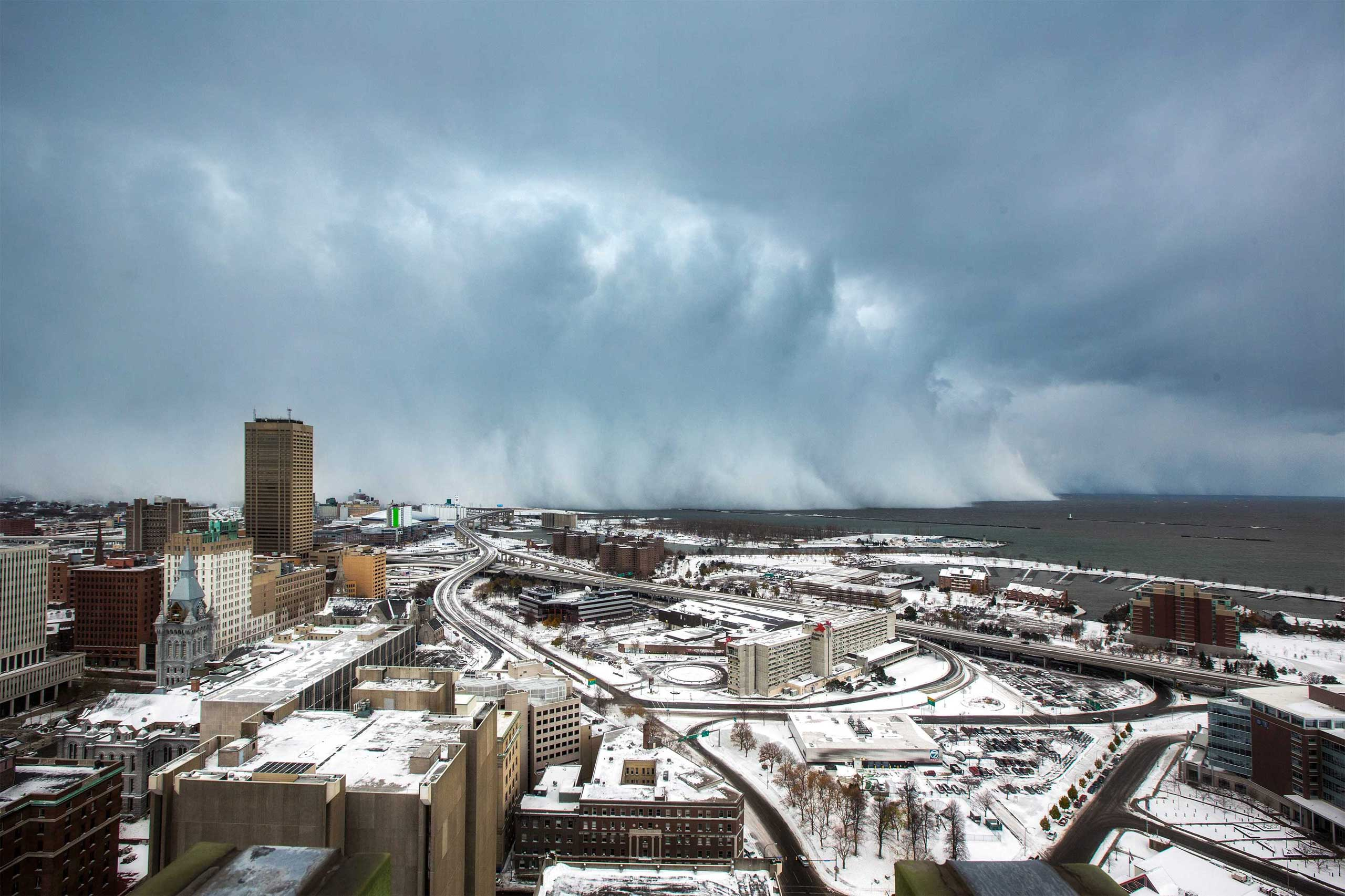 <b>Buffalo Snow Storm</b> Storm clouds and snow blow off Lake Erie in Buffalo, N.Y. on Nov. 18, 2014. An autumn blizzard dumped a year's worth of snow in three days on Western New York state, where five people died and residents, some stranded overnight in cars, braced for another pummeling expected later on Wednesday. REUTERS/Lindsay DeDario (UNITED STATES - Tags: ENVIRONMENT TPX IMAGES OF THE DAY)