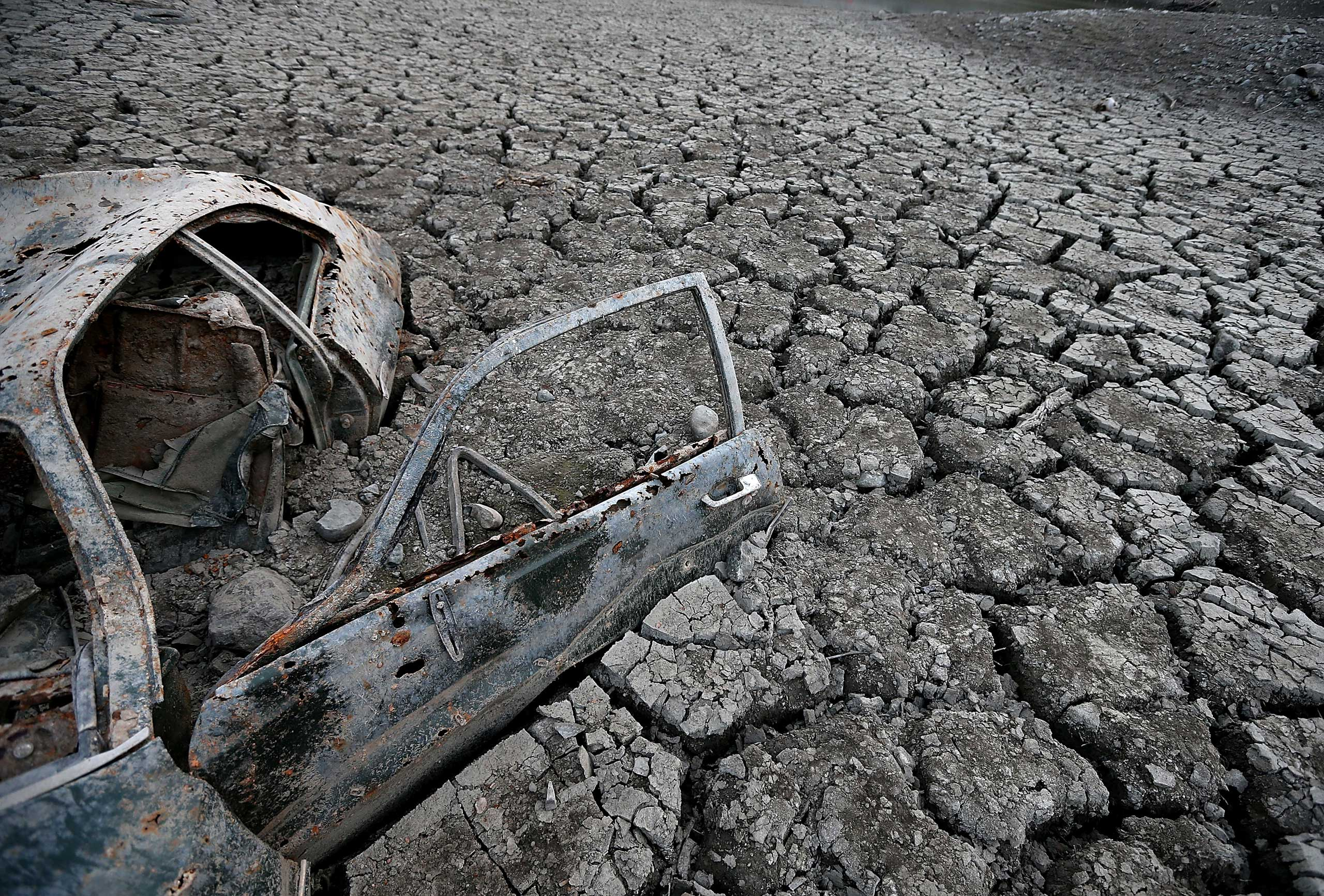 <b>California Drought</b> A car sits in dried and cracked earth of what was the bottom of the Almaden Reservoir in San Jose, Calif. on Jan. 28, 2014.