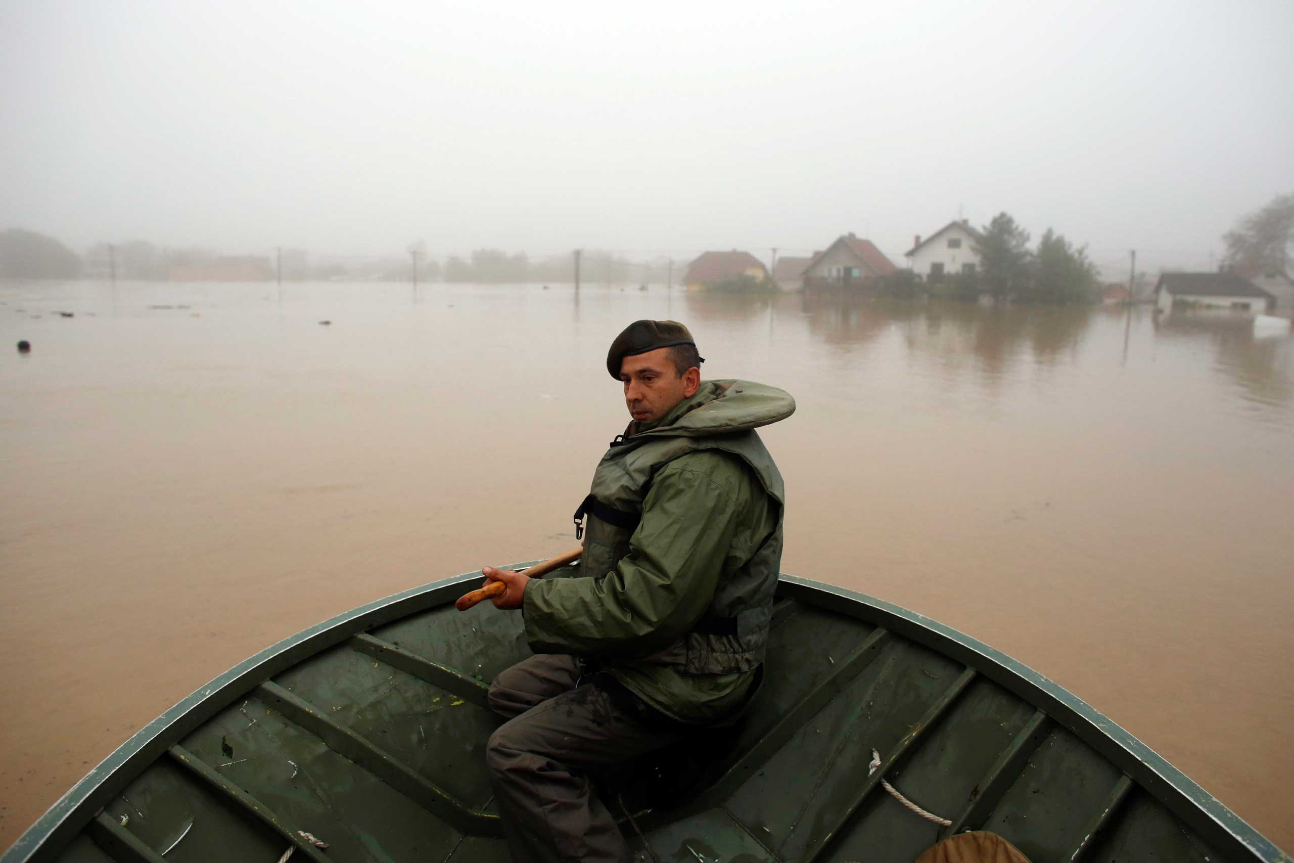<b>Balkan Floods</b> A Serbian army soldier rows a boat as he searches for people to be evacuated in the town of Obrenovac, southwest of Belgrade, Serba on May 16, 2014. The heaviest rains and floods in 120 years have hit Bosnia and Serbia.