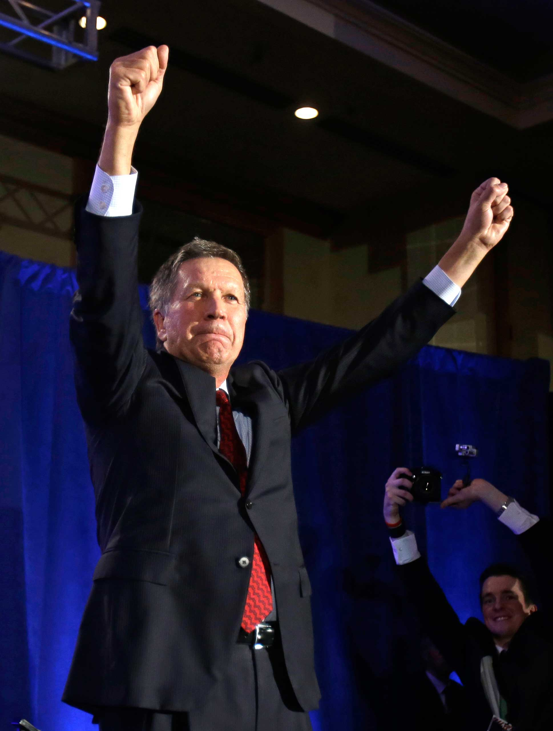<b>John Kasich</b> Ohio Gov. John Kasich practices his presidential victory pose at the Ohio Republican Party celebration on Tuesday, Nov. 4, 2014, in Columbus, Ohio.