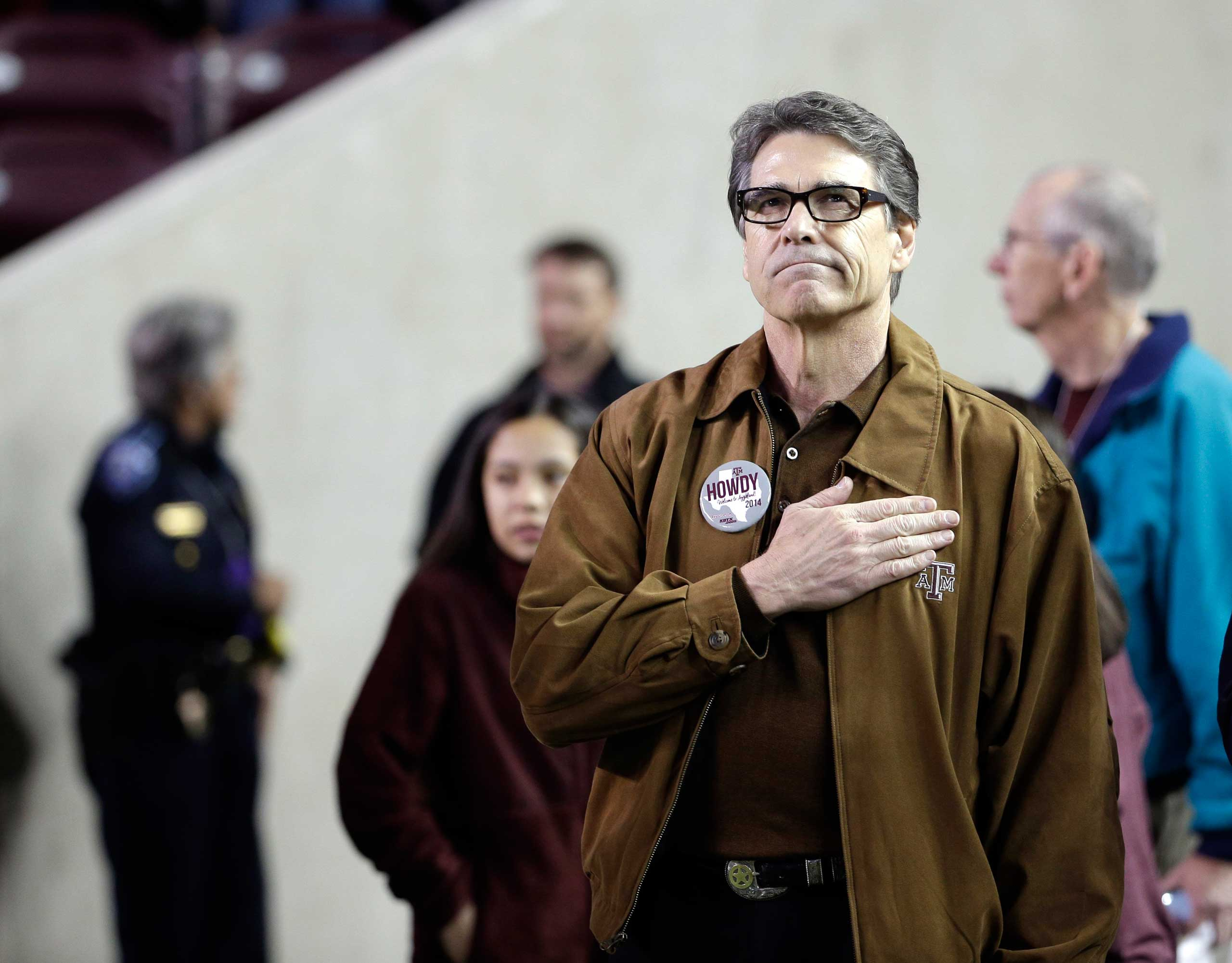 <b>Rick Perry</b> Texas Gov. Rick Perry looks powerfully patriotic during the National Anthem before an NCAA college football game on Nov. 27, 2014, in College Station, Texas.