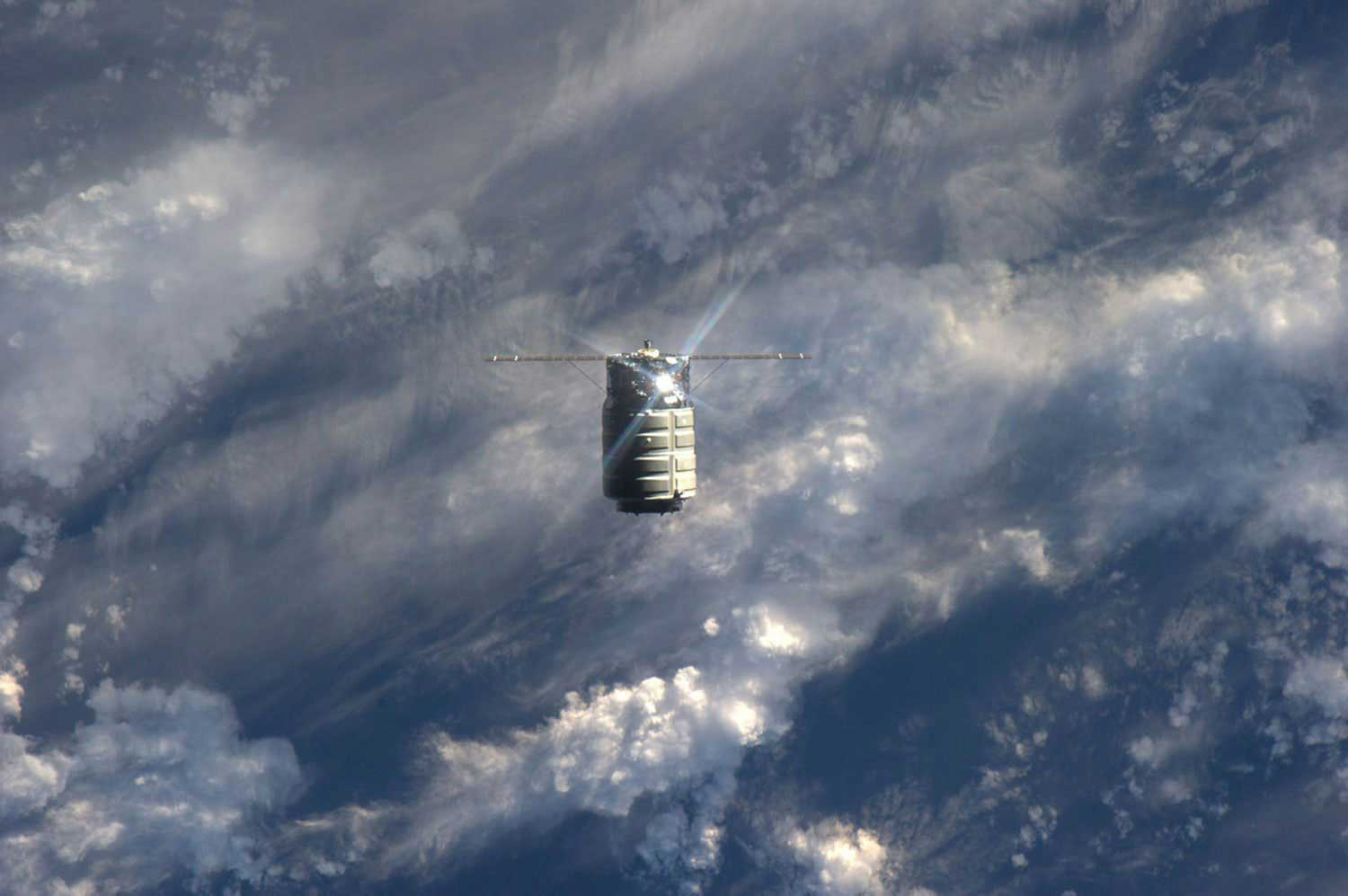 The unmanned U.S. commercial cargo ship Cygnus is seen approaching the International Space Station on Sept. 29, 2013. Cygnus flew itself to the International Space Station, completing the primary goal of its debut test flight before Station supply runs begin in December.