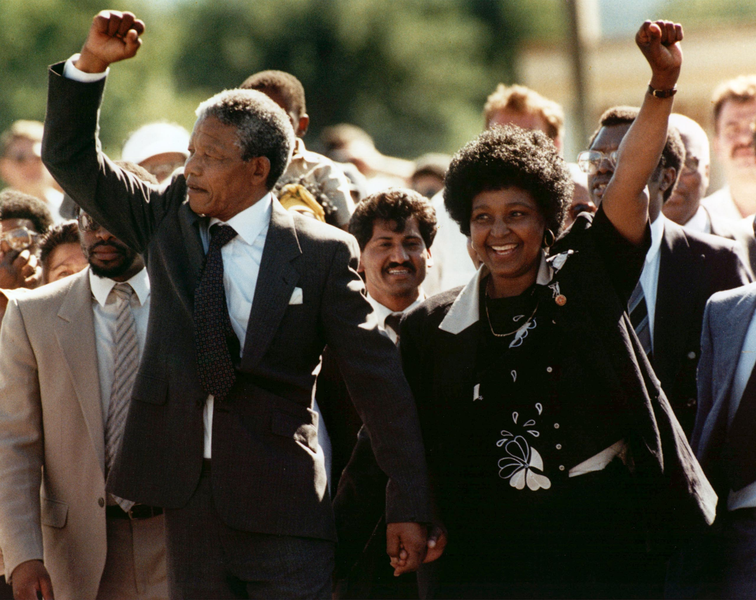 Nelson Mandela and wife Winnie, walking hand in hand, raise clenched fists upon his release from Victor prison in Cape Town on Feb. 11, 1990.